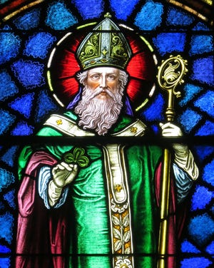A stained-glass window at Saint Patrick Catholic Church in Junction City, Ohio, depicts Saint Patrick.