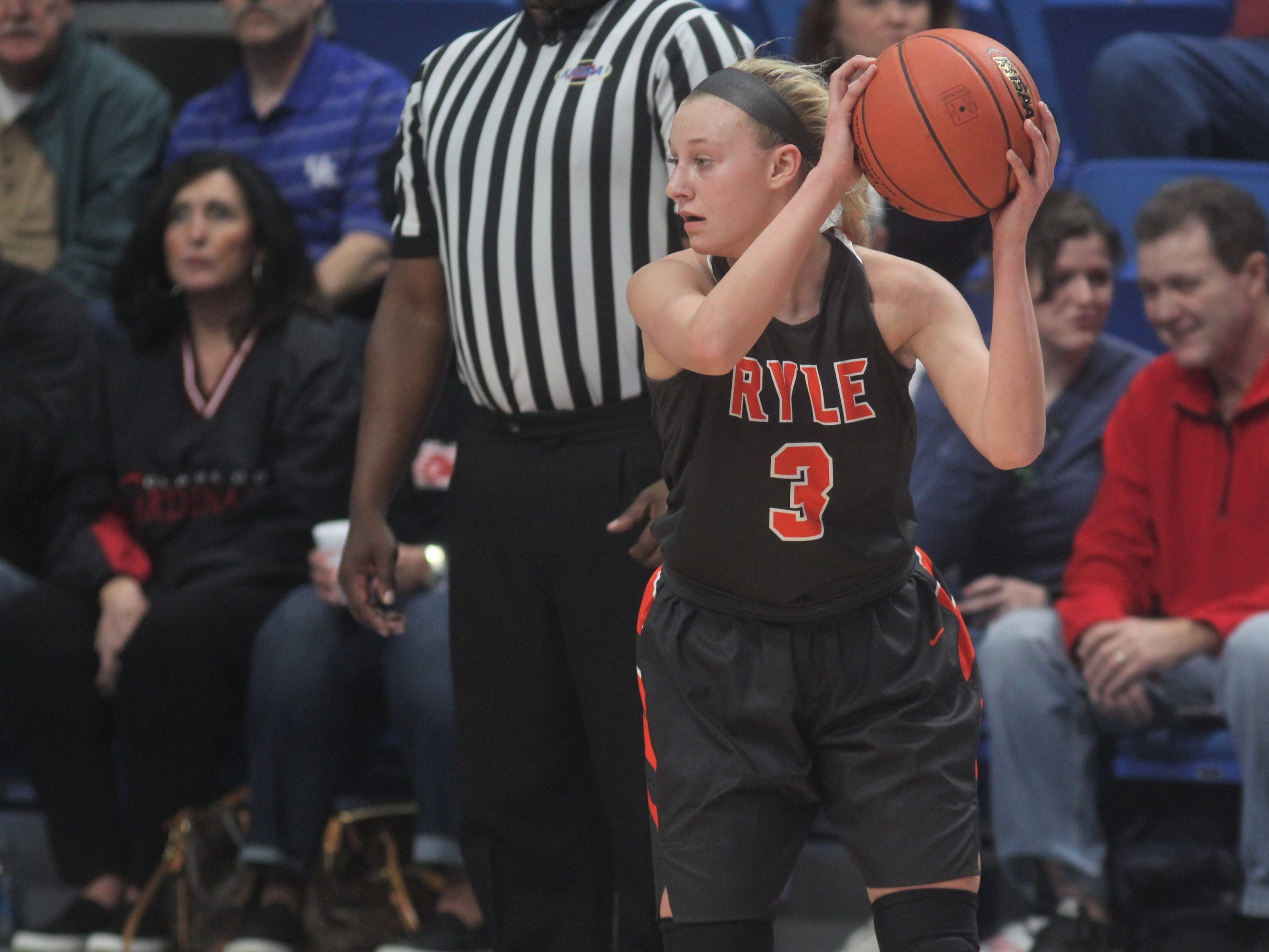 Ryle sophomore Brie Crittendon looks to pass to a teammate as Ryle defeated George Rogers Clark 64-51 in the state quarterfinals of the KHSAA Sweet 16 girls basketball tournament March 15, 2019 at Rupp Arena, Lexington KY.