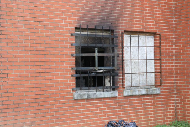 A charred window at the Frosty Morn building after a fire on Thursday, March 14, 2019.