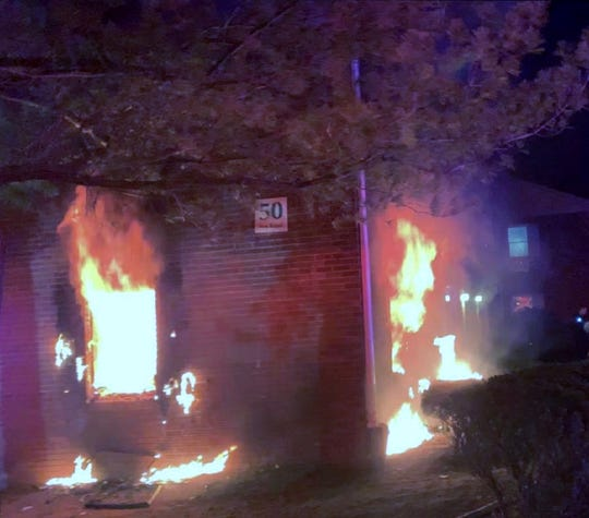 Firefighters rescued two tenants from a burning apartment building Thursday night.