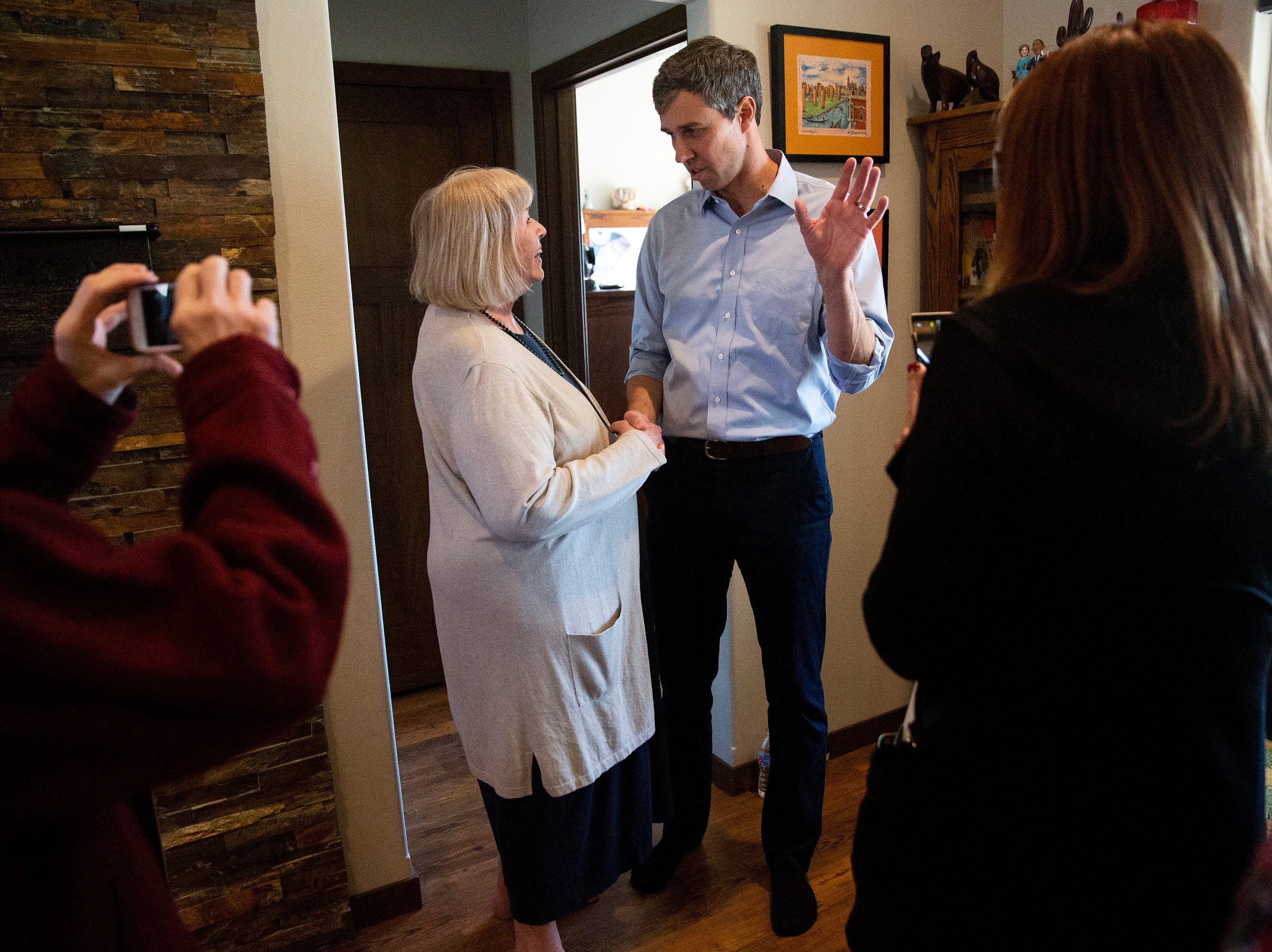 Beto O'Rourke, Democratic candidate for president, shakes hands with people who attended a house party to hear him speak on Friday, March 15, 2019, in Fairfield. This is O'Rourke's first trip to Iowa after announcing his campaign.