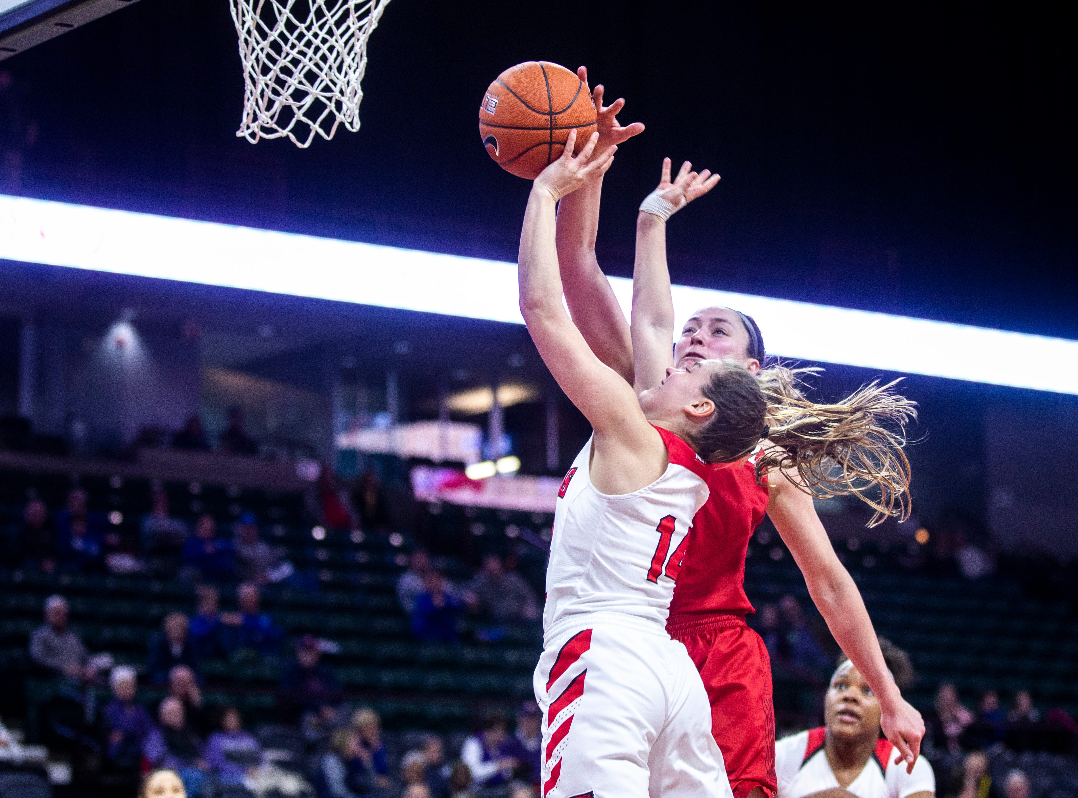 Illinois State guard Paige Saylor (14) gets her shot blocked by Bradley forward Chelsea Brackmann during a NCAA Missouri Valley Conference women's basketball quarterfinal tournament game, Friday, March 15, 2019, at the TaxSlayer Center in Moline, Illinois.