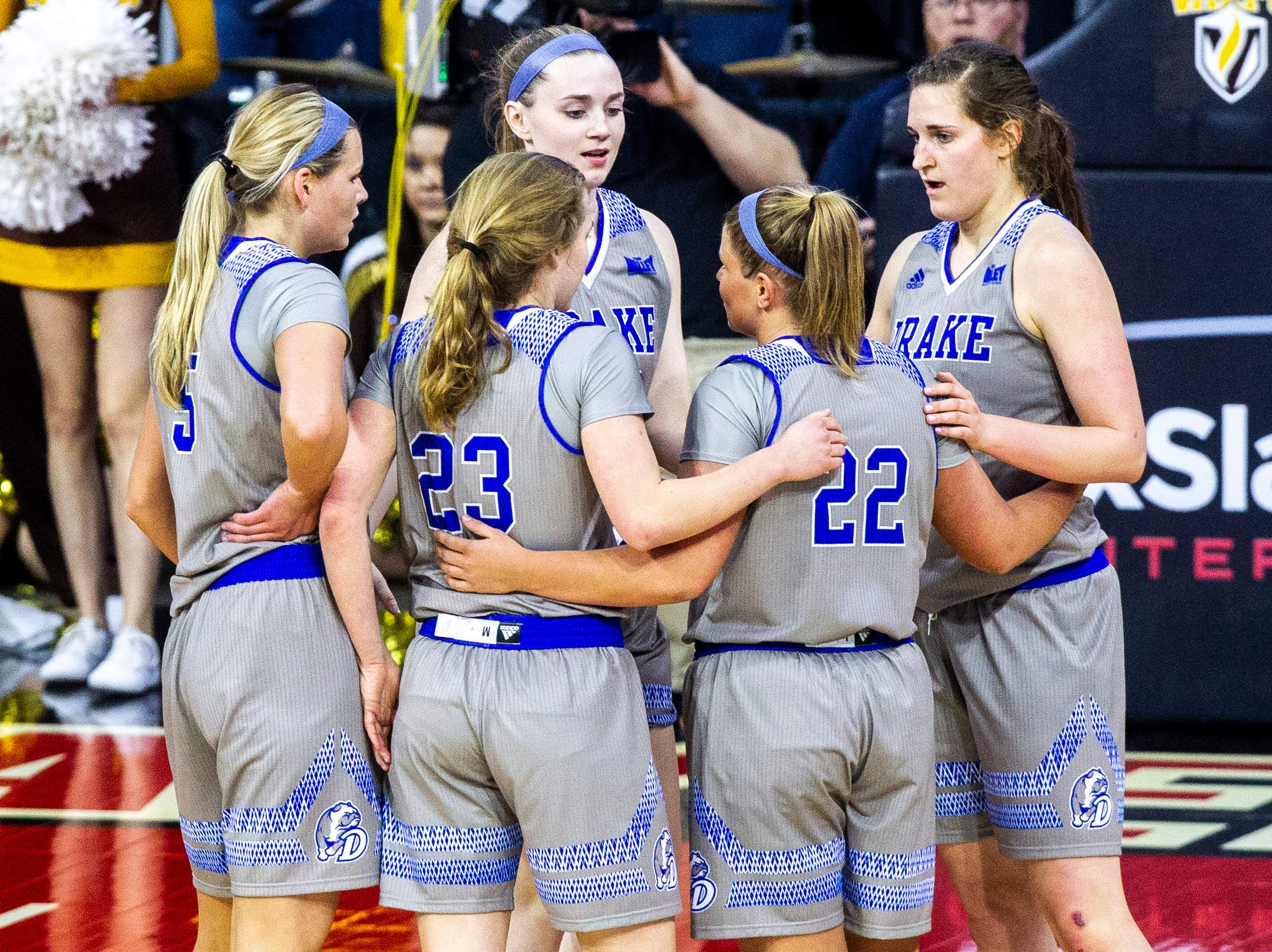 Drake Bulldogs, from left, Becca Hittner (5), Maggie Negaard (23) Mya Mertz, Hannah Fuller (22) and Monica Burich huddle up during a NCAA Missouri Valley Conference women's basketball quarterfinal tournament game, Friday, March 15, 2019, at the TaxSlayer Center in Moline, Illinois.