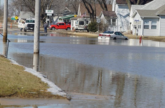 Parts of Missouri Valley, a western Iowa city, remained flooded Friday, March 15, 2019, after a partial evacuation was ordered two days earlier.