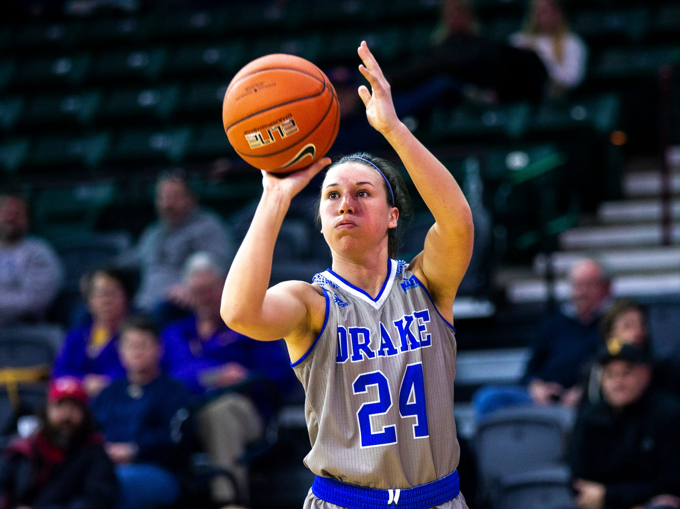 Drake guard Nicole Miller (24) shoots a 3-point basket during a NCAA Missouri Valley Conference women's basketball quarterfinal tournament game, Friday, March 15, 2019, at the TaxSlayer Center in Moline, Illinois.