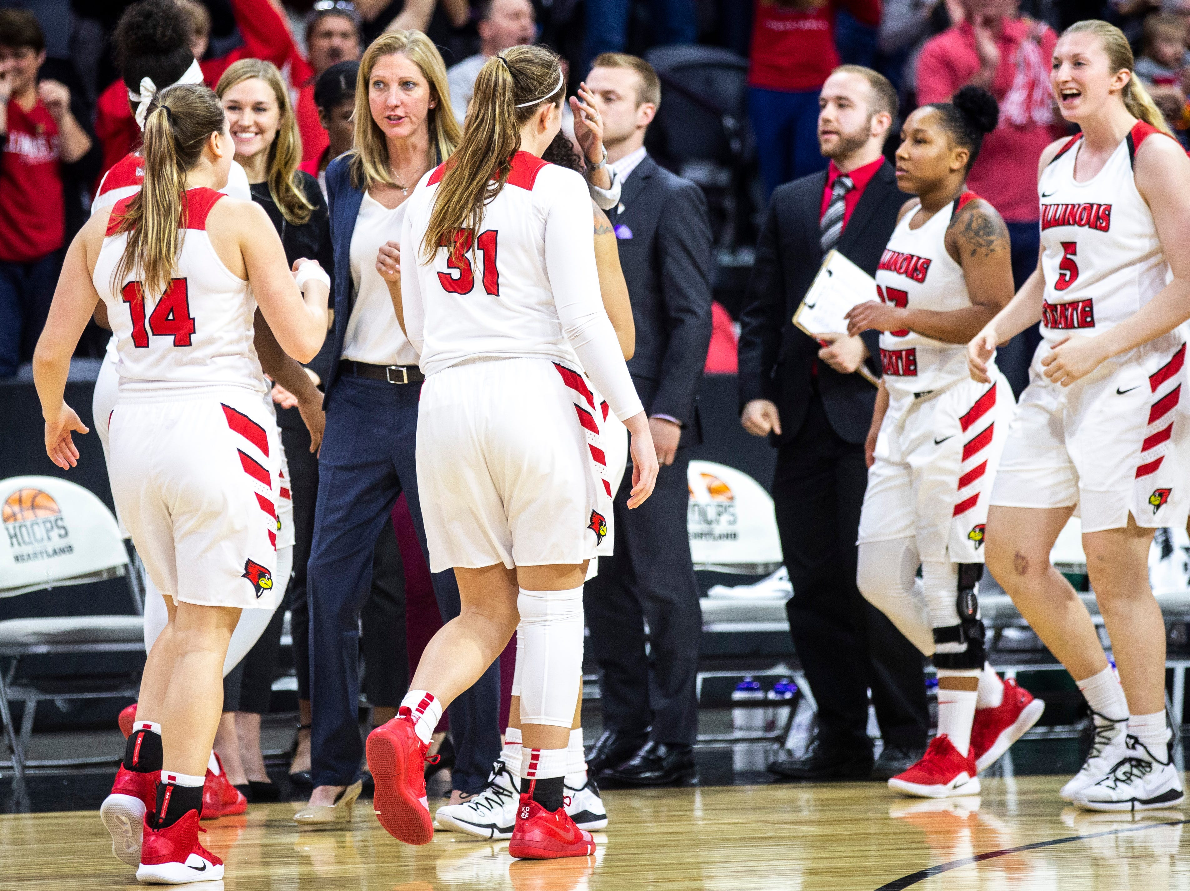 Illinois State head coach Kristen Gillespie celebrates with players after a NCAA Missouri Valley Conference women's basketball quarterfinal against Bradley tournament game, Friday, March 15, 2019, at the TaxSlayer Center in Moline, Illinois.