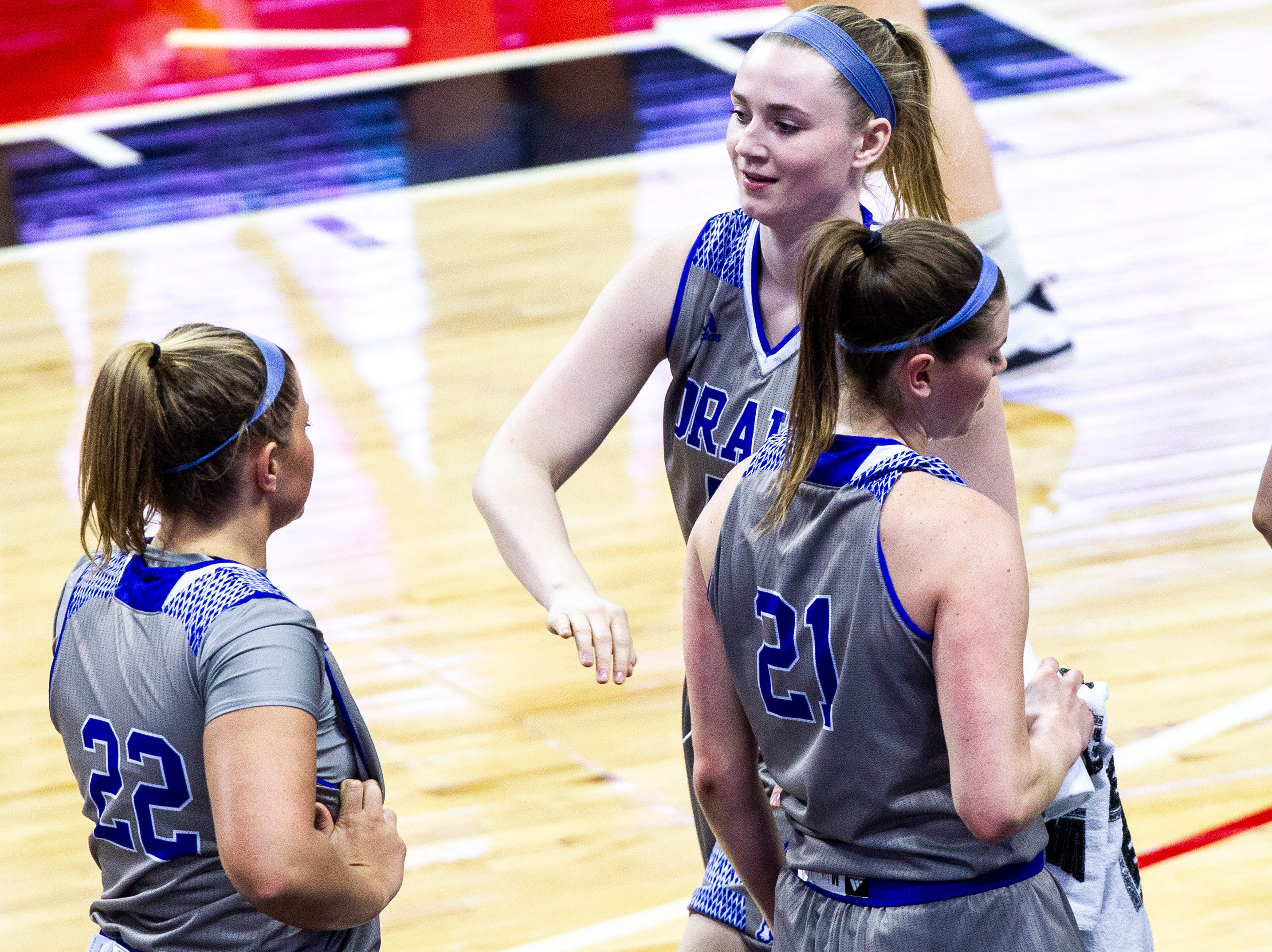 Drake's Mya Mertz high-fives teammates while heading to the bench during a NCAA Missouri Valley Conference women's basketball quarterfinal tournament game, Friday, March 15, 2019, at the TaxSlayer Center in Moline, Illinois.
