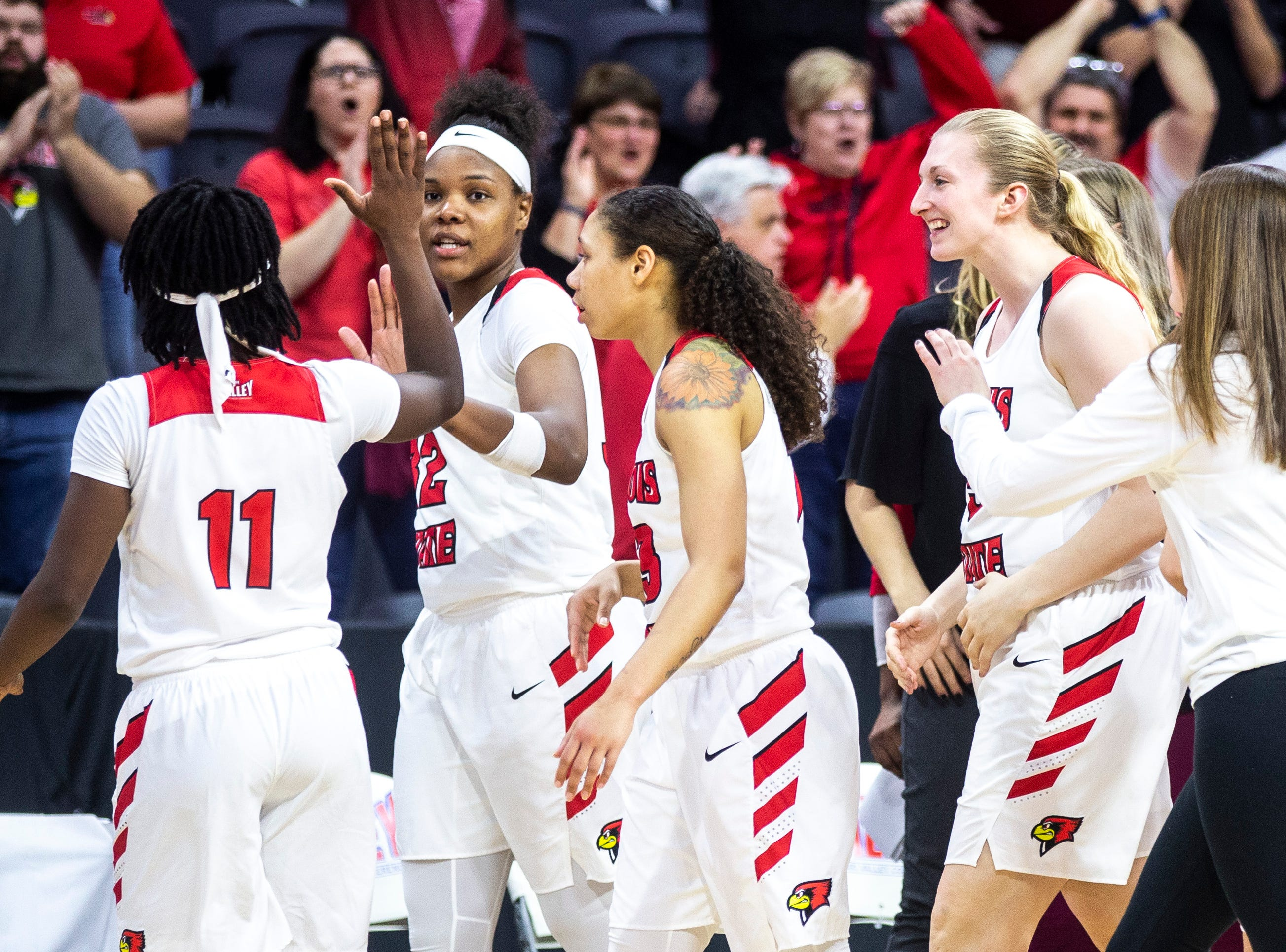 Illinois State forward Simone Goods (32) gets a high-five from Illinois State guard Tete Maggett (11) after a NCAA Missouri Valley Conference women's basketball quarterfinal tournament game against Bradley, Friday, March 15, 2019, at the TaxSlayer Center in Moline, Illinois.