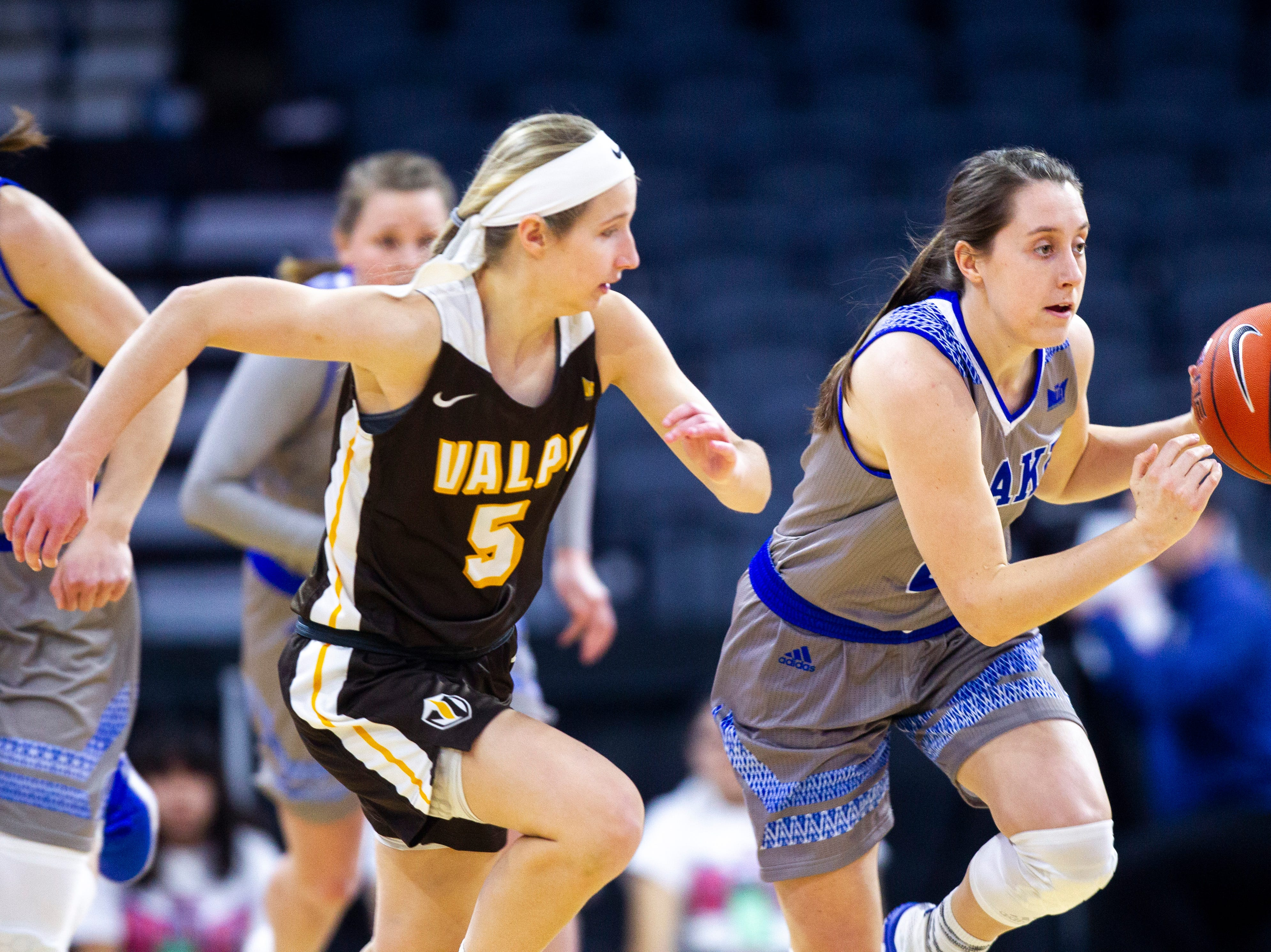 Drake guard Maddie Monahan, right, takes the ball up court while Valparaiso guard Shay Frederick (5) defends during a NCAA Missouri Valley Conference women's basketball quarterfinal tournament game, Friday, March 15, 2019, at the TaxSlayer Center in Moline, Illinois.