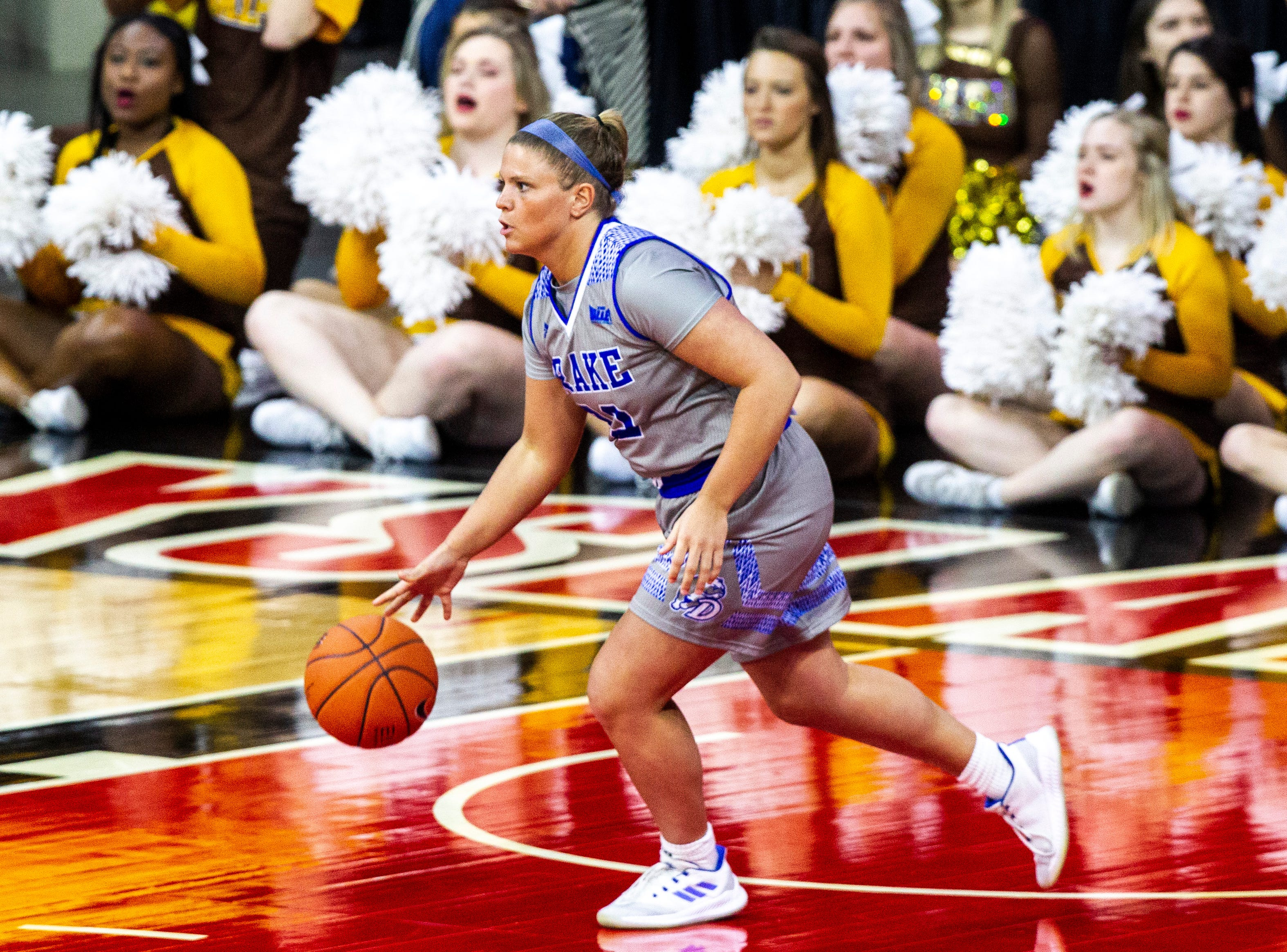 Drake guard Maddy Dean (20) takes the ball up court during a NCAA Missouri Valley Conference women's basketball quarterfinal tournament game, Friday, March 15, 2019, at the TaxSlayer Center in Moline, Illinois.