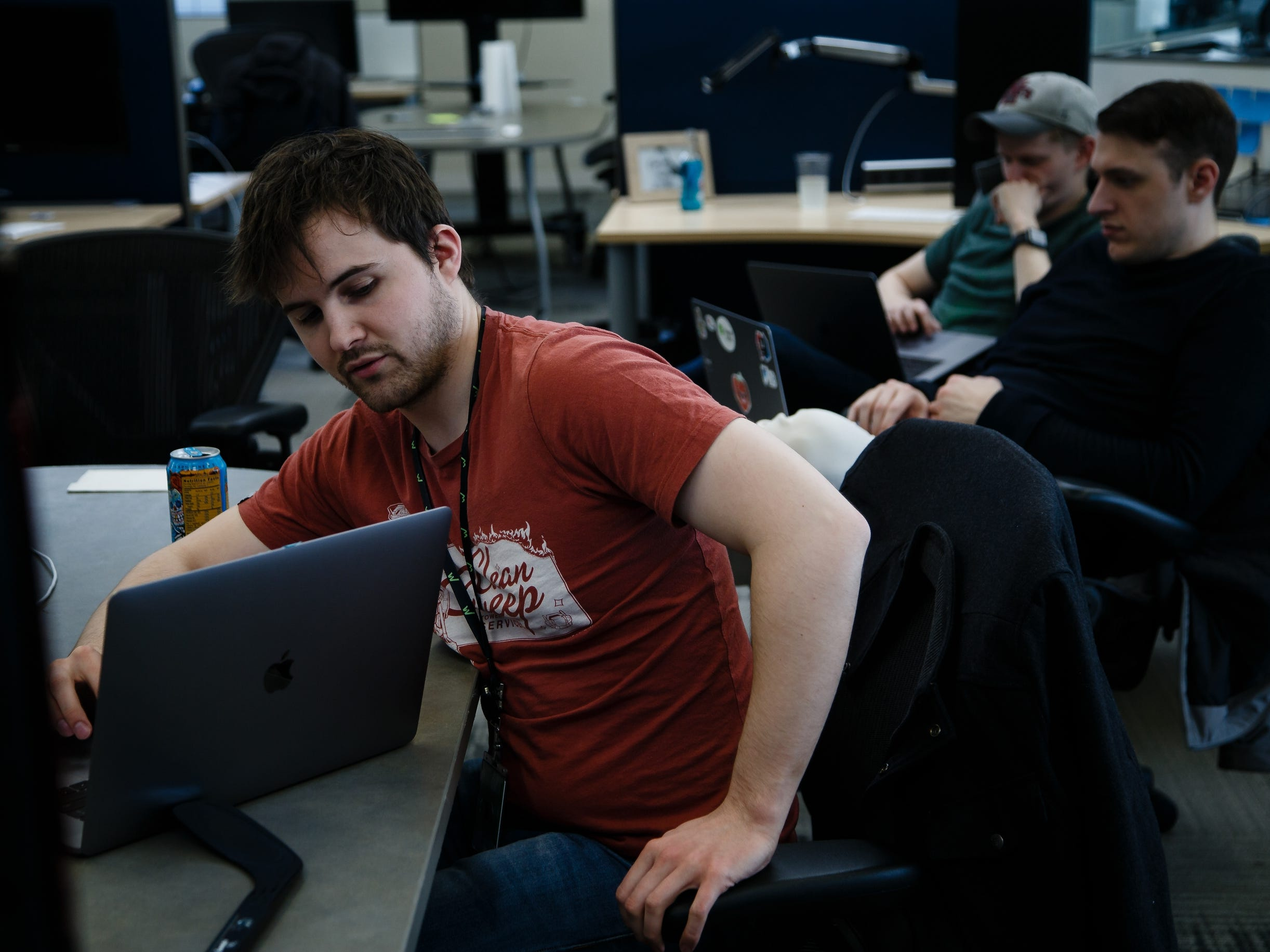 James Murphy of Ames, works on a project with a group at Workiva, a tech company in Ames on Friday, March 15, 2019.