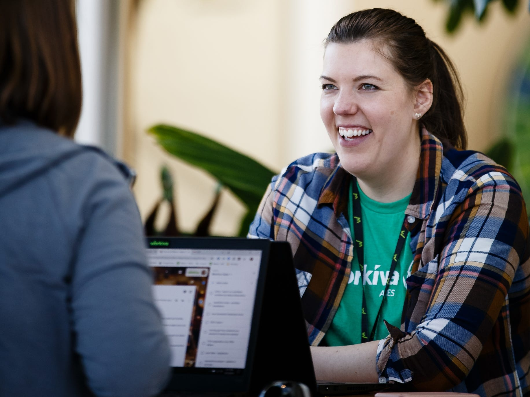 Stephanie Ruzicka, 29 of Ames, works in the atrium of Workiva, a tech company in Ames on Friday, March 15, 2019.