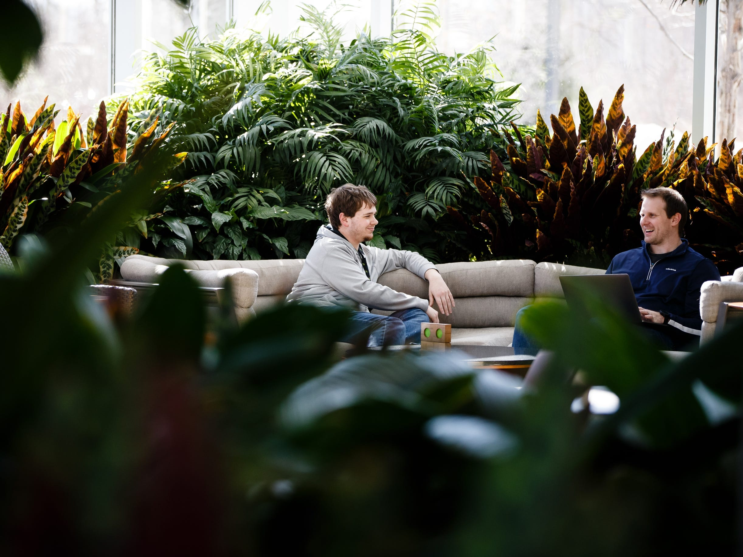 Bretton Finch, left, of Ankeny and Joel Marks, right, of West Des Moines, work in the atrium of Workiva, a tech company in Ames on Friday, March 15, 2019.
