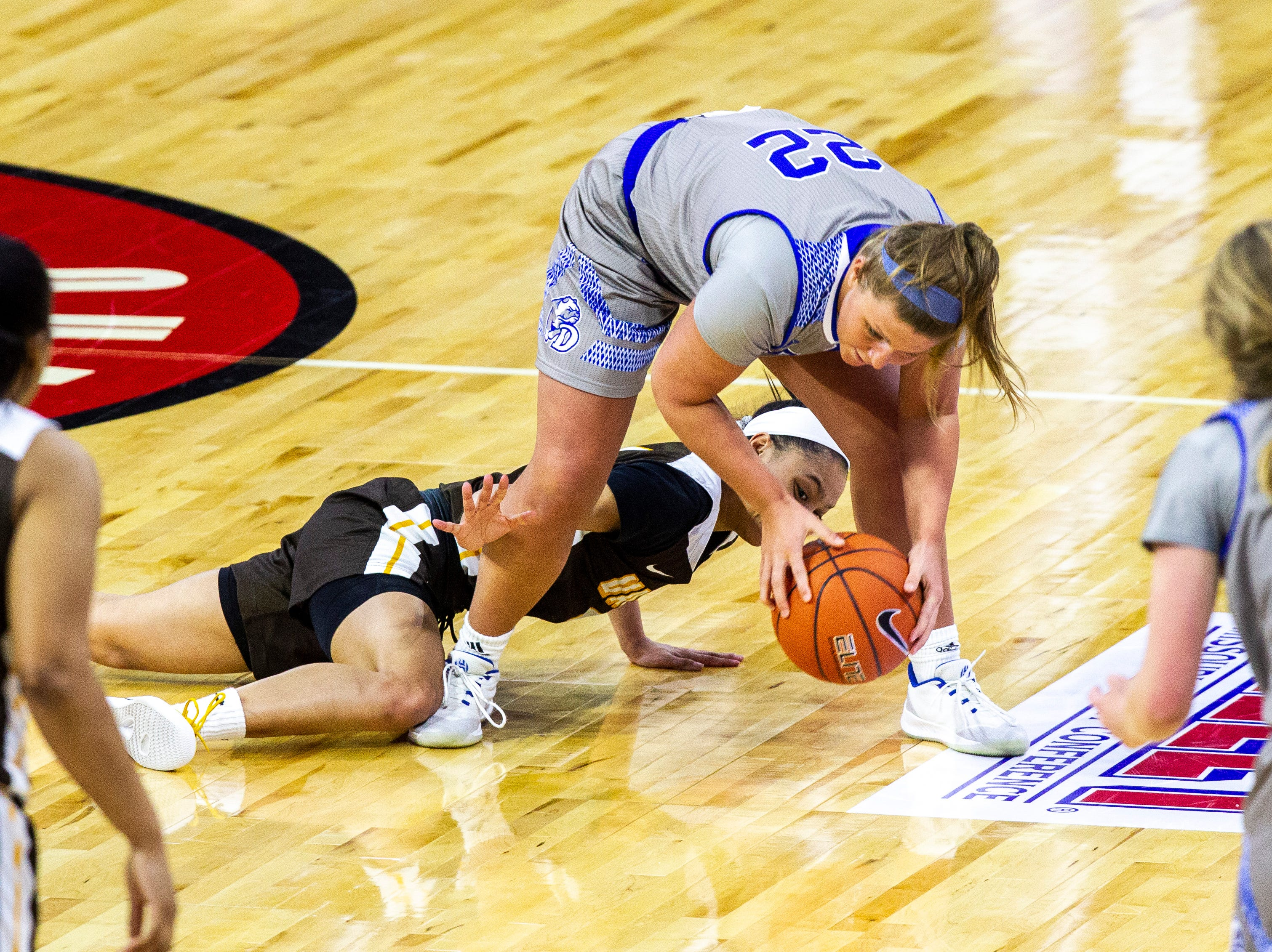 Drake guard Hannah Fuller (22) grabs a loose ball away from Valparaiso guard Ilysse Pitts (4) during a NCAA Missouri Valley Conference women's basketball quarterfinal tournament game, Friday, March 15, 2019, at the TaxSlayer Center in Moline, Illinois.