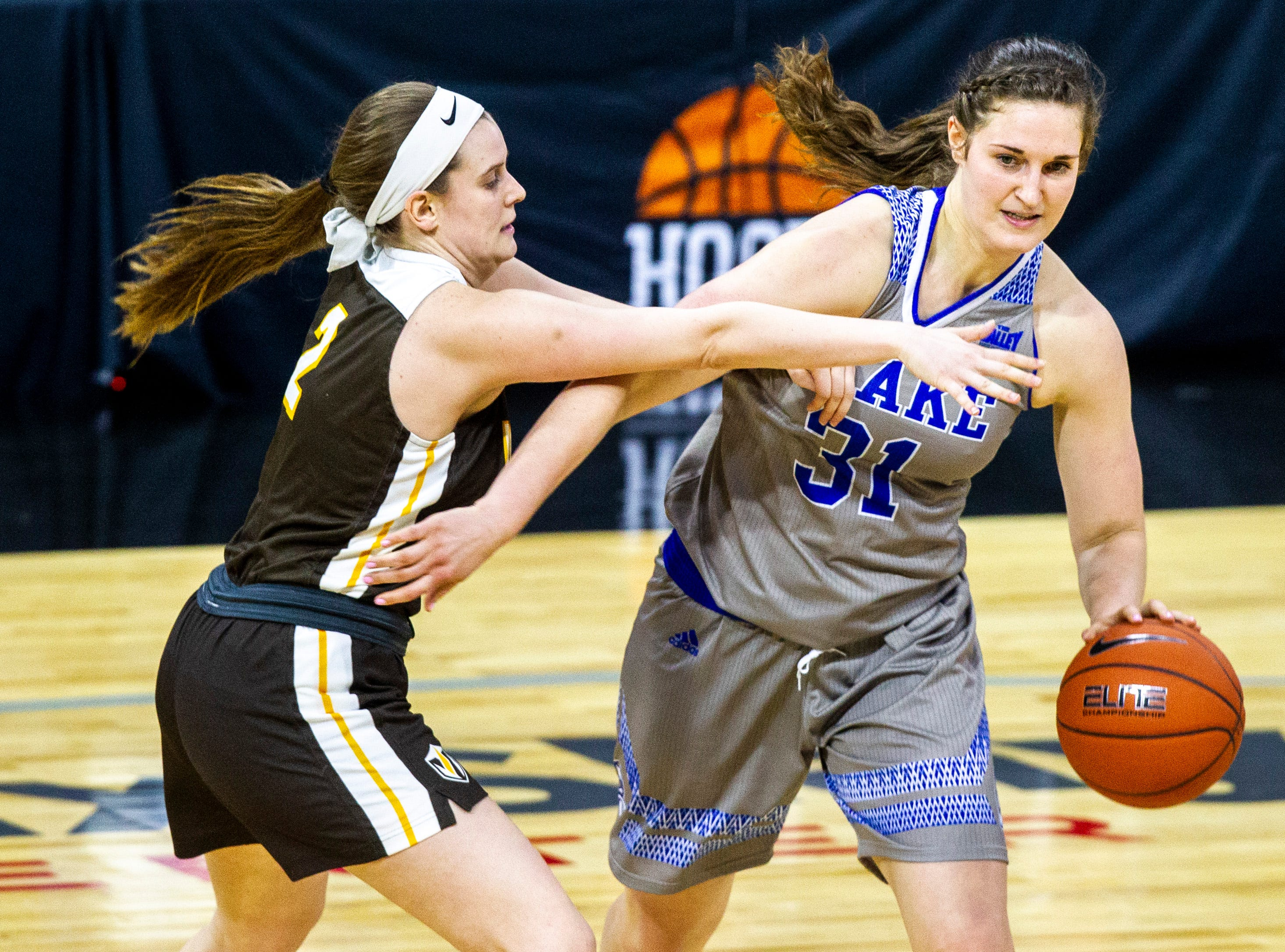 Drake forward Monica Burich (31) dribbles while Valparaiso guard Meredith Hamlet (2) defends during a NCAA Missouri Valley Conference women's basketball quarterfinal tournament game, Friday, March 15, 2019, at the TaxSlayer Center in Moline, Illinois.