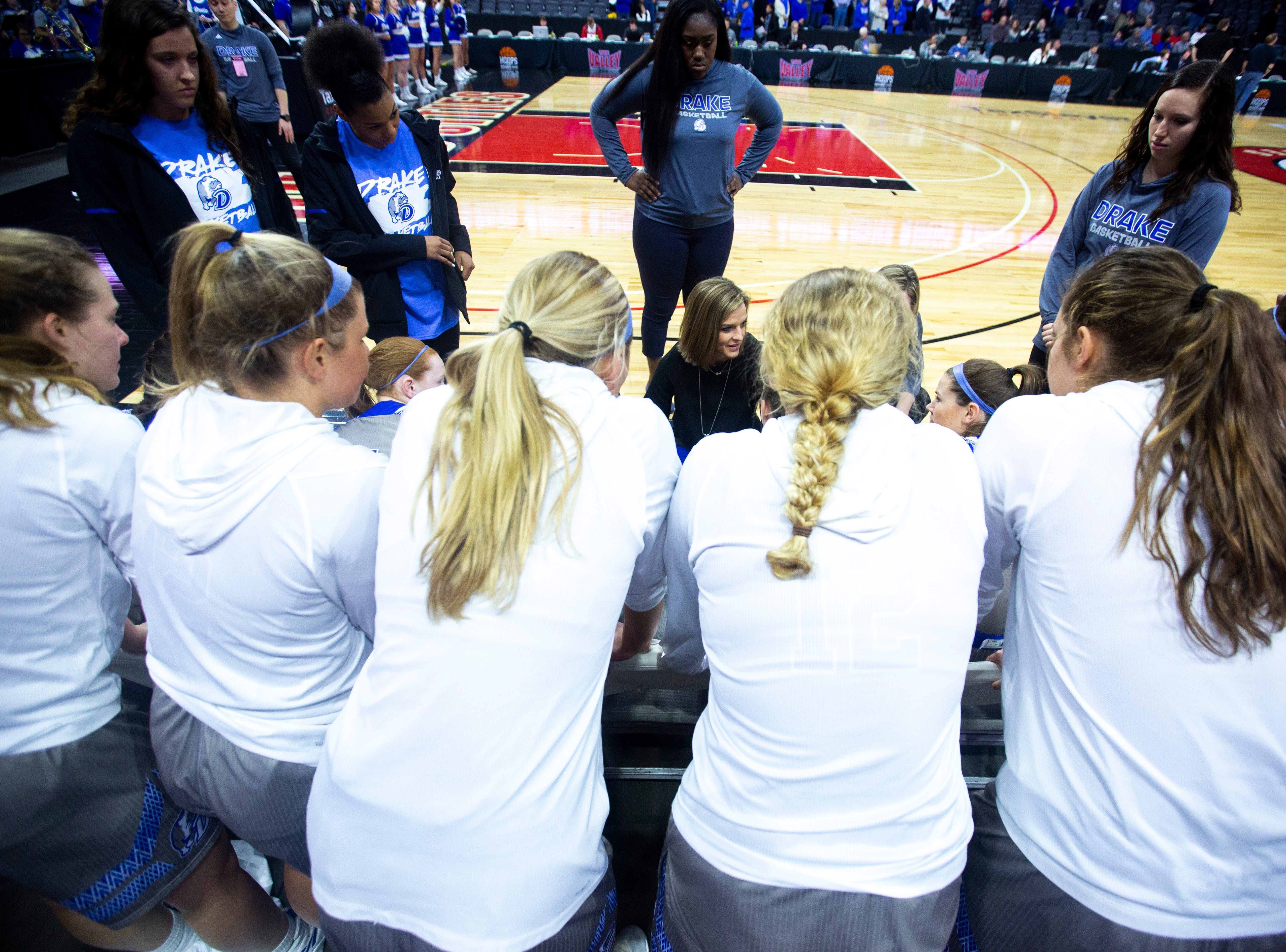 Drake head coach Jennie Baranczyk talks with players before a NCAA Missouri Valley Conference women's basketball quarterfinal tournament game, Friday, March 15, 2019, at the TaxSlayer Center in Moline, Illinois.