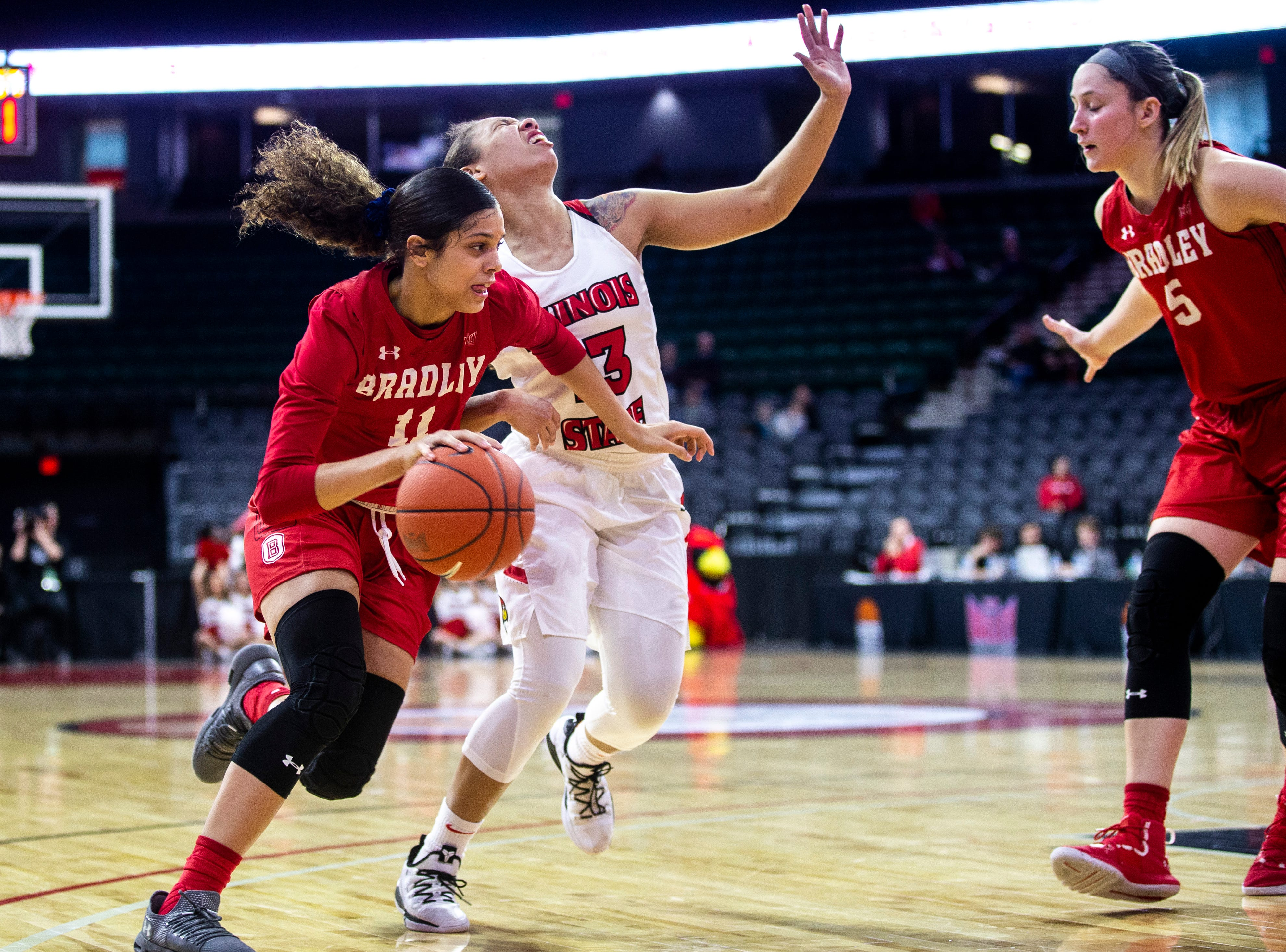 Illinois State guard Katrina Beck (13) reacts after colliding with Bradley's Lasha Petree (11) during a NCAA Missouri Valley Conference women's basketball quarterfinal tournament game, Friday, March 15, 2019, at the TaxSlayer Center in Moline, Illinois.