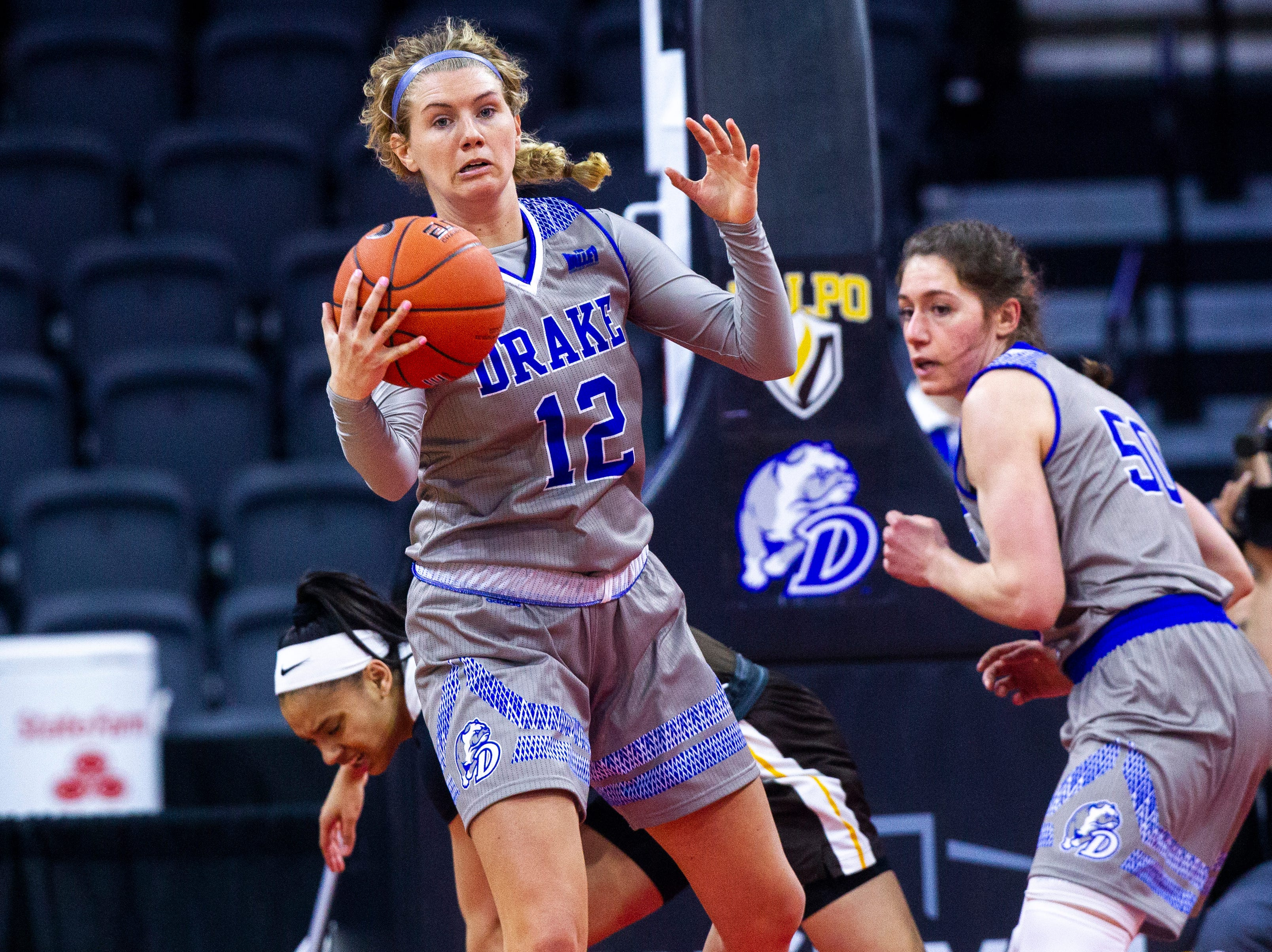 Drake's Brenni Rose (12) grabs a rebound during a NCAA Missouri Valley Conference women's basketball quarterfinal tournament game, Friday, March 15, 2019, at the TaxSlayer Center in Moline, Illinois.
