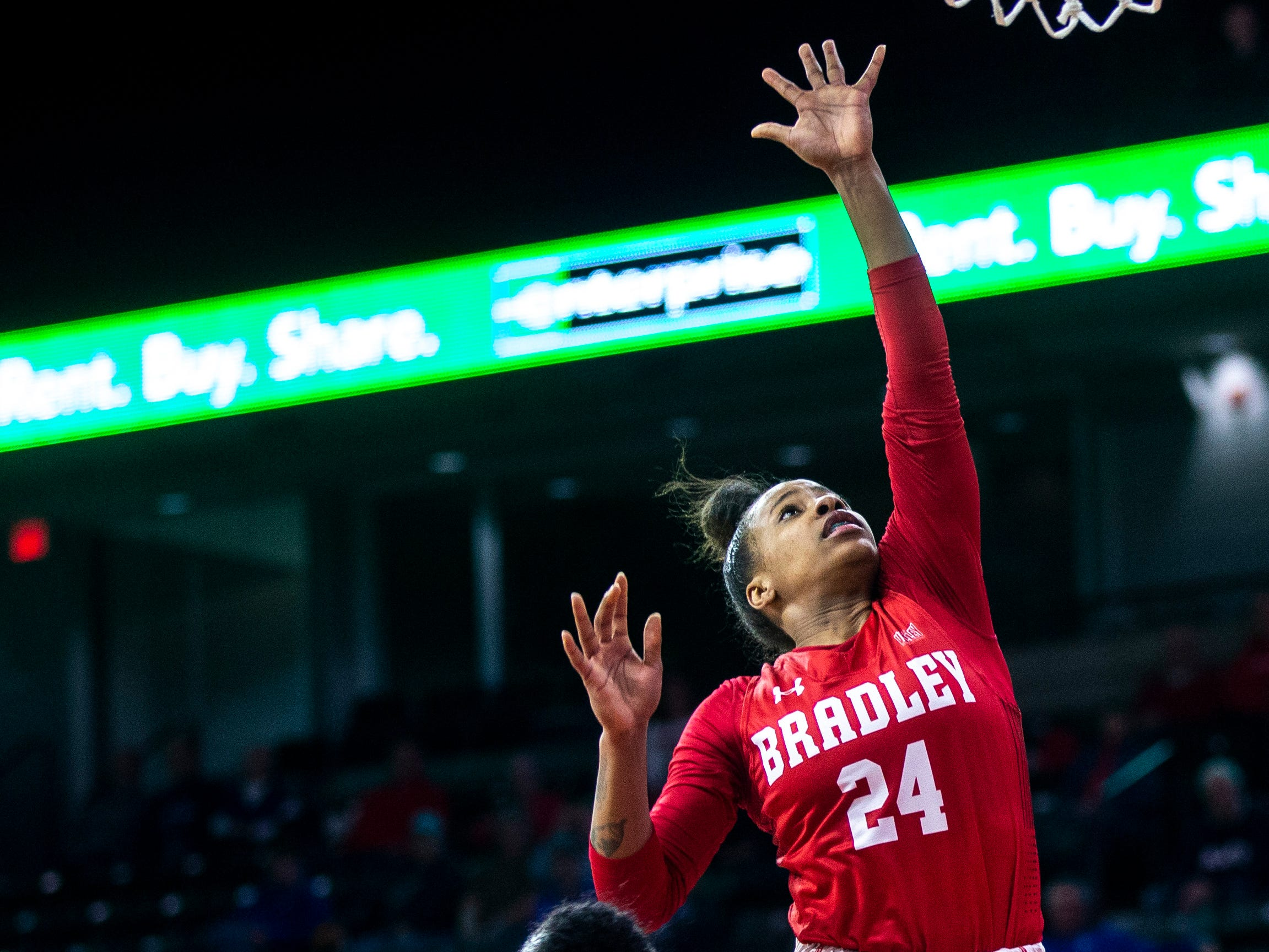 Bradley guard Shunseere Kent (24) attempts a basket while Illinois State guard Viria Livingston (23) defends during a NCAA Missouri Valley Conference women's basketball quarterfinal tournament game, Friday, March 15, 2019, at the TaxSlayer Center in Moline, Illinois.