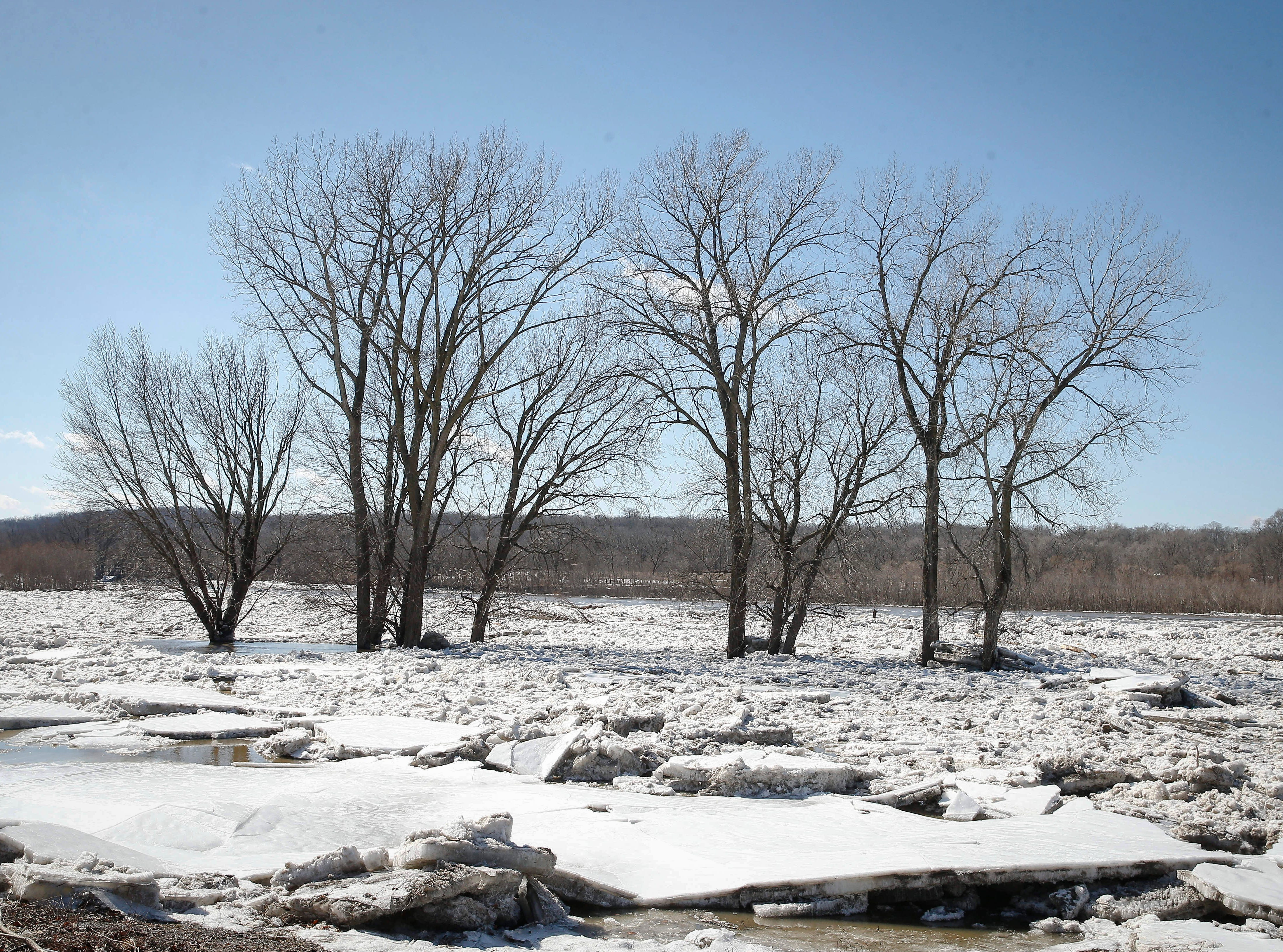 Large chunks of ice pile up along the swollen Des Moines River at Ledges Park on Friday, March 15, 2019.