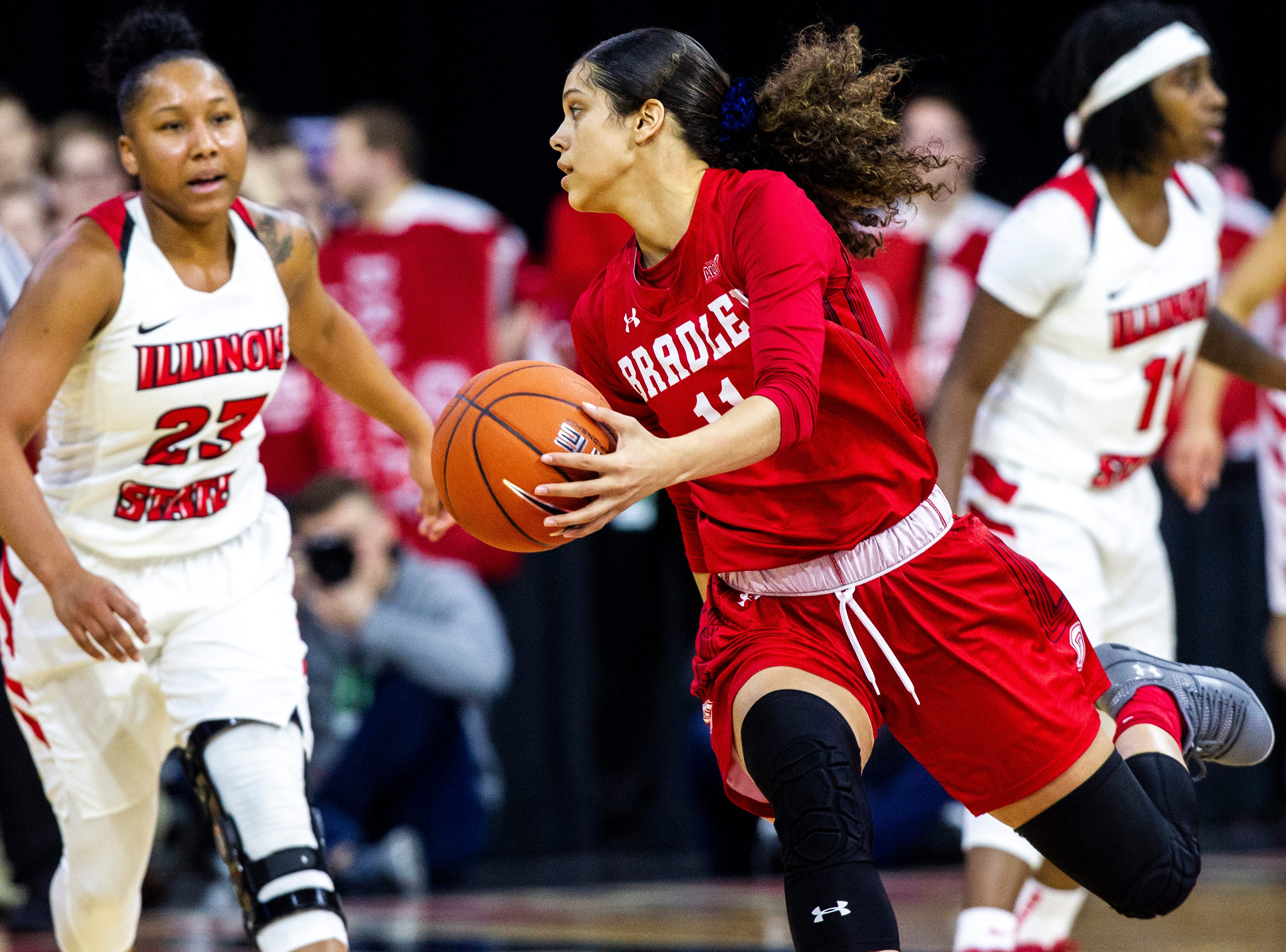Illinois State guard Viria Livingston (23) defends Bradley guard Lasha Petree (11) during a NCAA Missouri Valley Conference women's basketball quarterfinal tournament game, Friday, March 15, 2019, at the TaxSlayer Center in Moline, Illinois.
