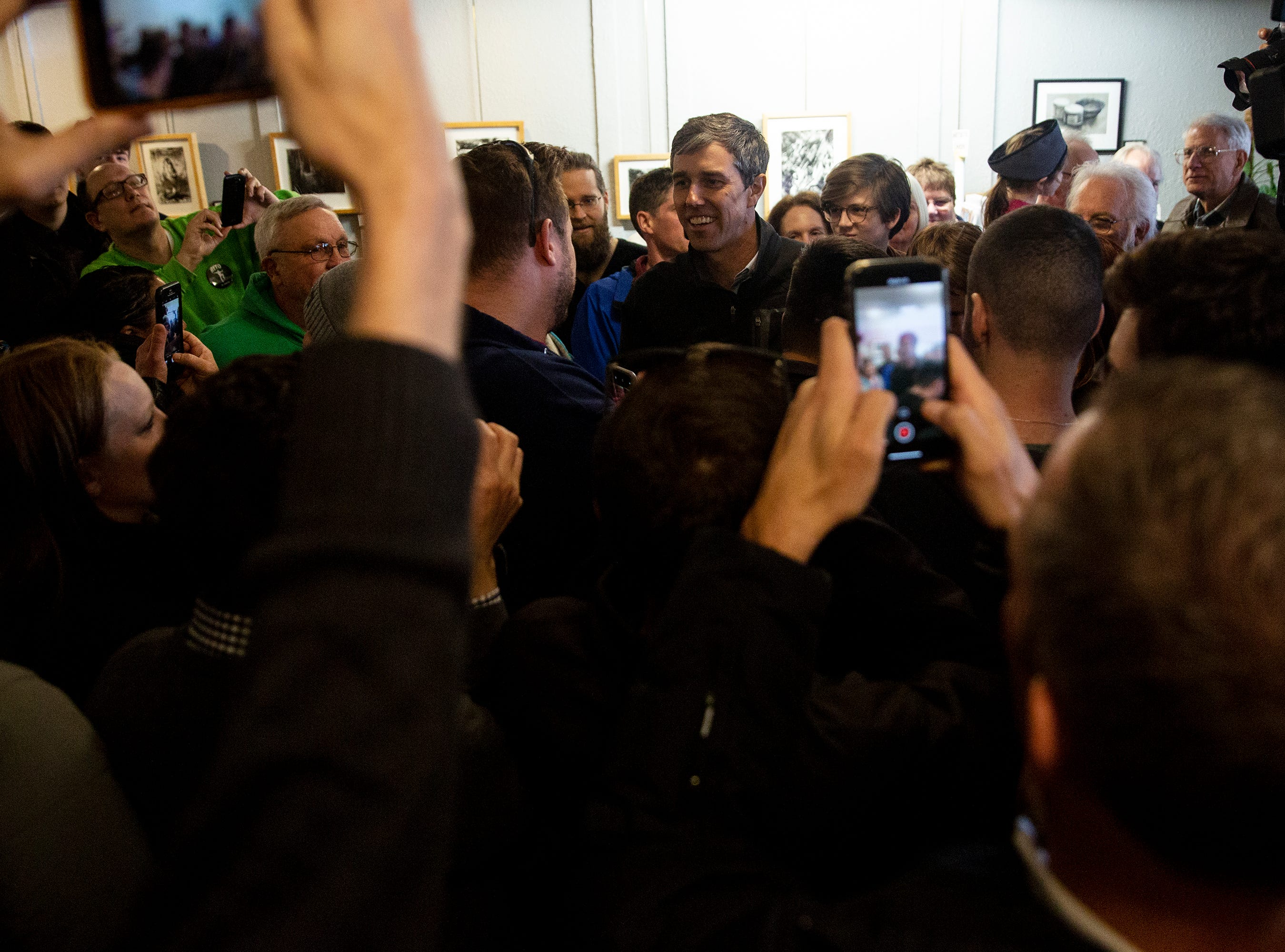 Beto O'Rourke, Democratic candidate for president, enters the crush of people gathered to see him on Friday, March 15, 2019, in Washington. This is O'Rourke's first trip to Iowa after announcing his campaign.