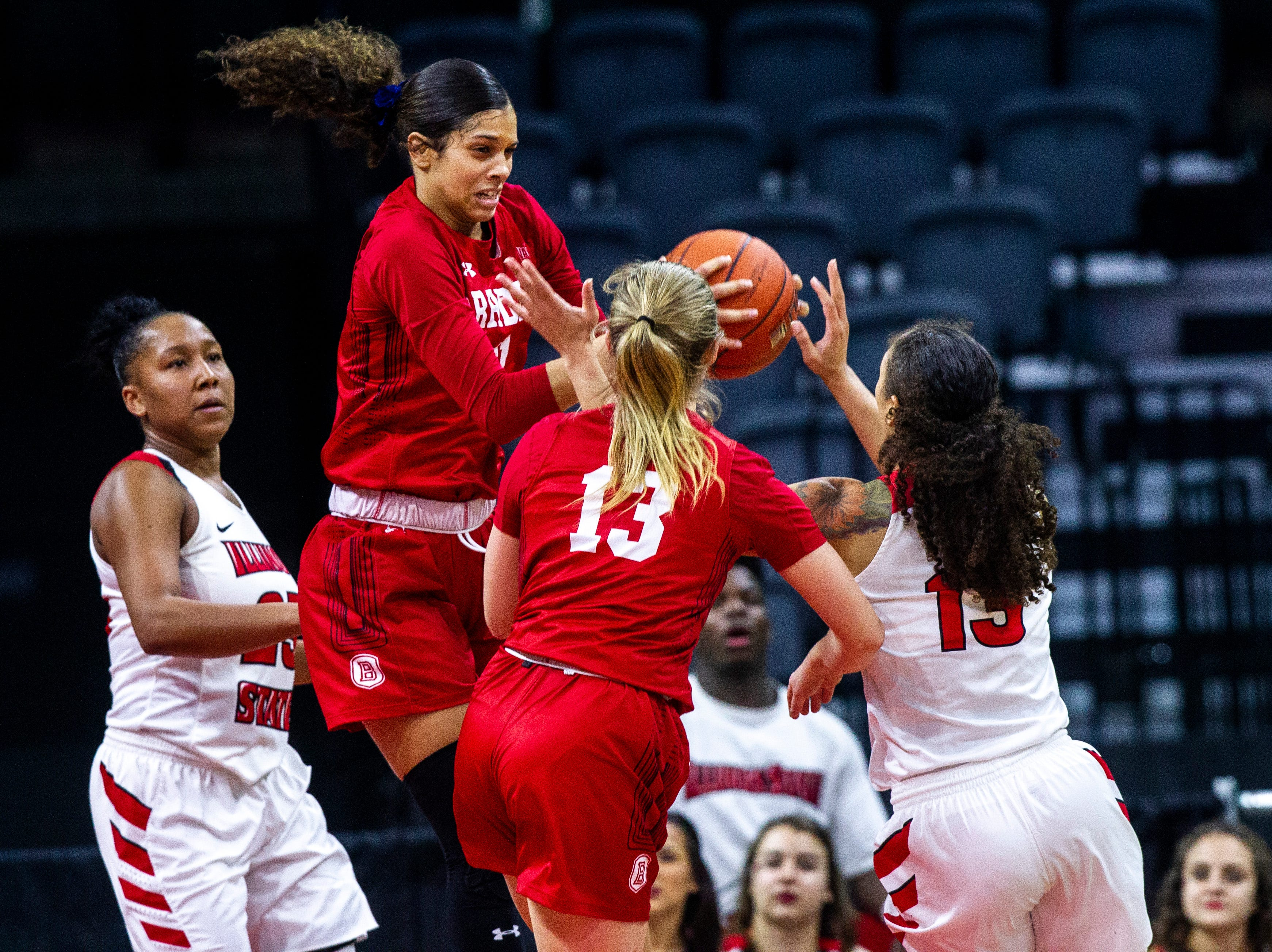Bradley guard Lasha Petree (11) attempts to grab a rebound against Illinois State guard Katrina Beck (13) during a NCAA Missouri Valley Conference women's basketball quarterfinal tournament game, Friday, March 15, 2019, at the TaxSlayer Center in Moline, Illinois.