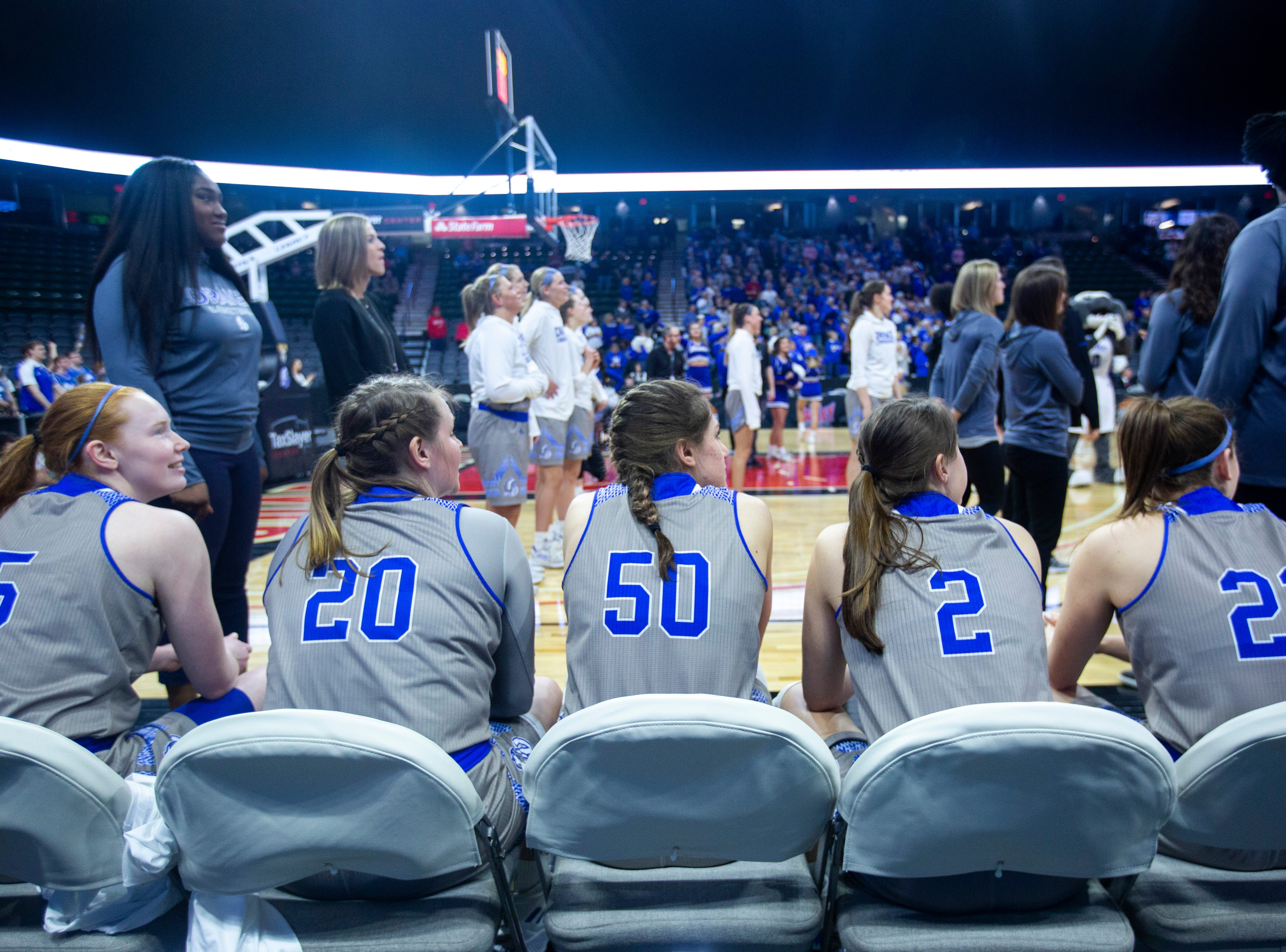 Drake Bulldogs players wait to be introduced during a NCAA Missouri Valley Conference women's basketball quarterfinal tournament game, Friday, March 15, 2019, at the TaxSlayer Center in Moline, Illinois.