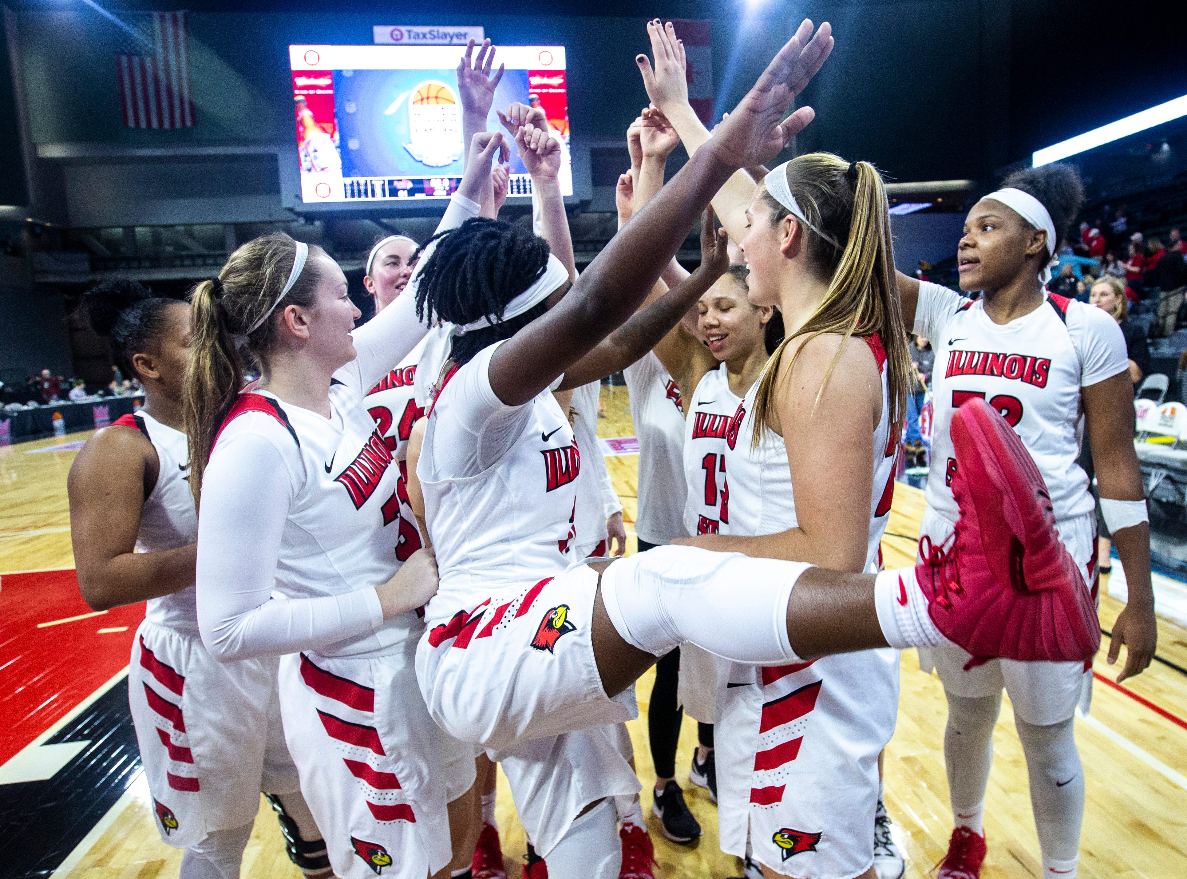 Illinois State Redbirds celebrate after a NCAA Missouri Valley Conference women's basketball quarterfinal against Bradley tournament game, Friday, March 15, 2019, at the TaxSlayer Center in Moline, Illinois.