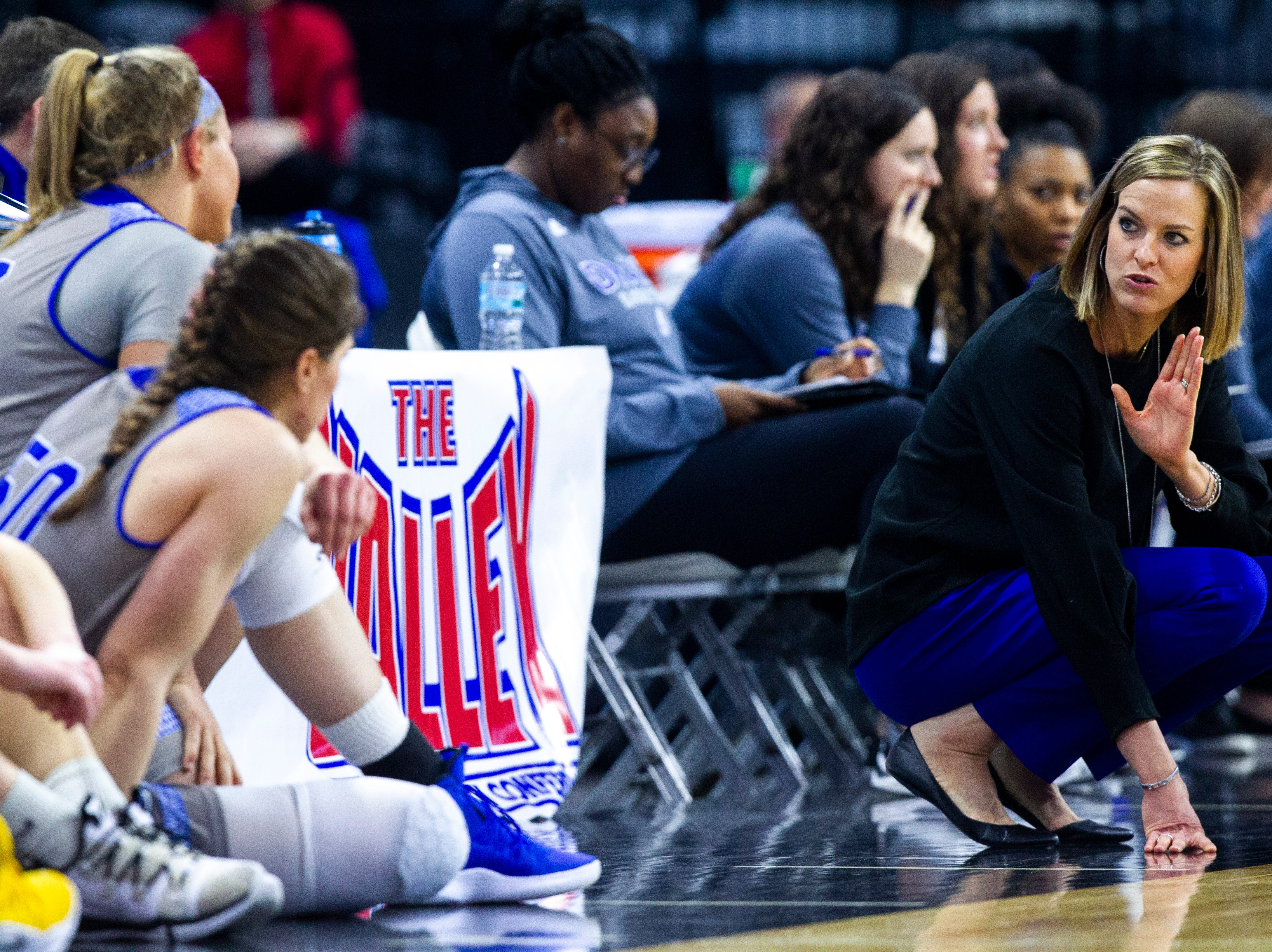 Drake head coach Jennie Baranczyk, right, talks with players waiting to check into the game during a NCAA Missouri Valley Conference women's basketball quarterfinal tournament game, Friday, March 15, 2019, at the TaxSlayer Center in Moline, Illinois.