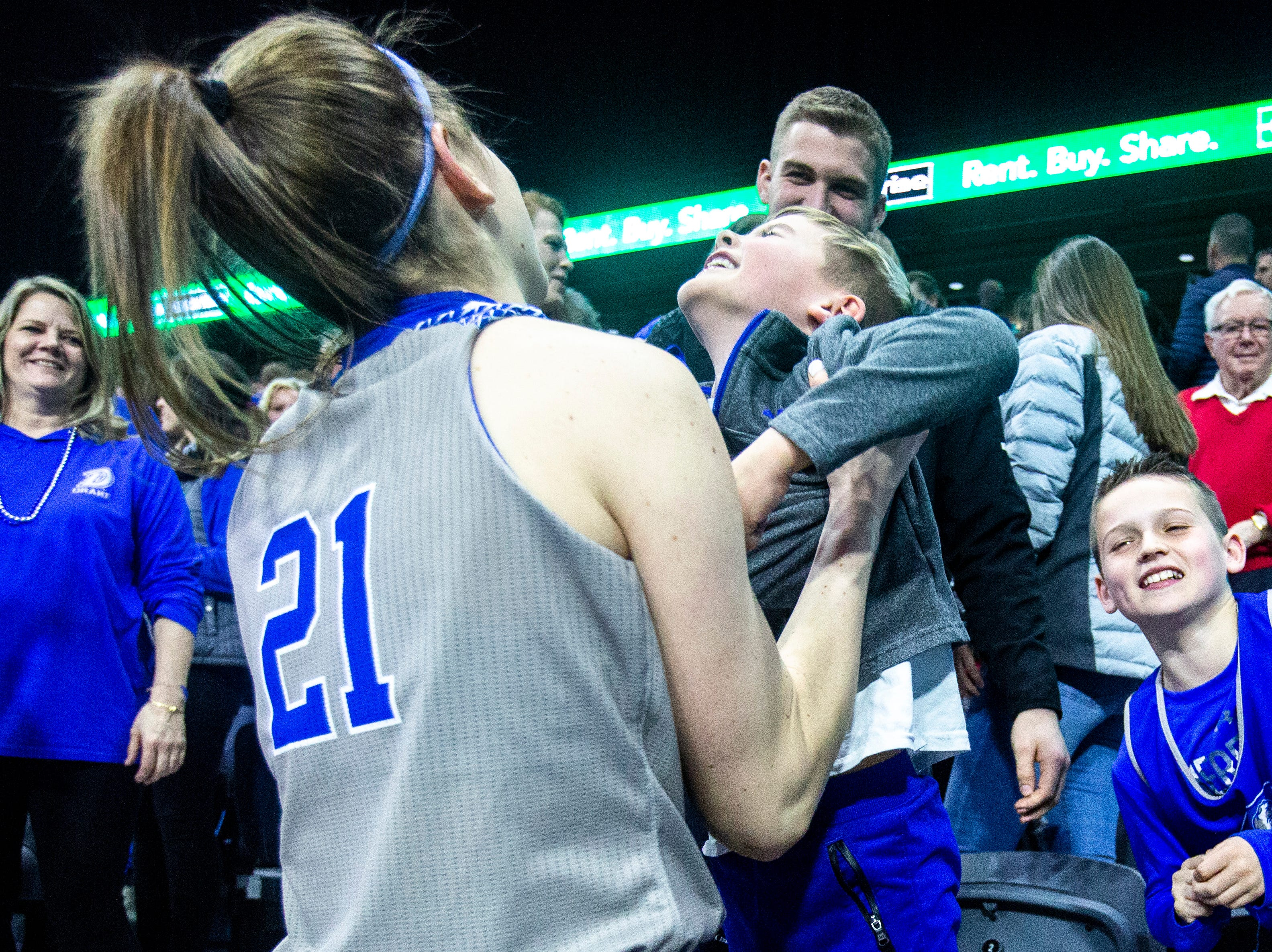 Drake guard Sammie Bachrodt (21) celebrates with family and friends after a NCAA Missouri Valley Conference women's basketball quarterfinal tournament game, Friday, March 15, 2019, at the TaxSlayer Center in Moline, Illinois.