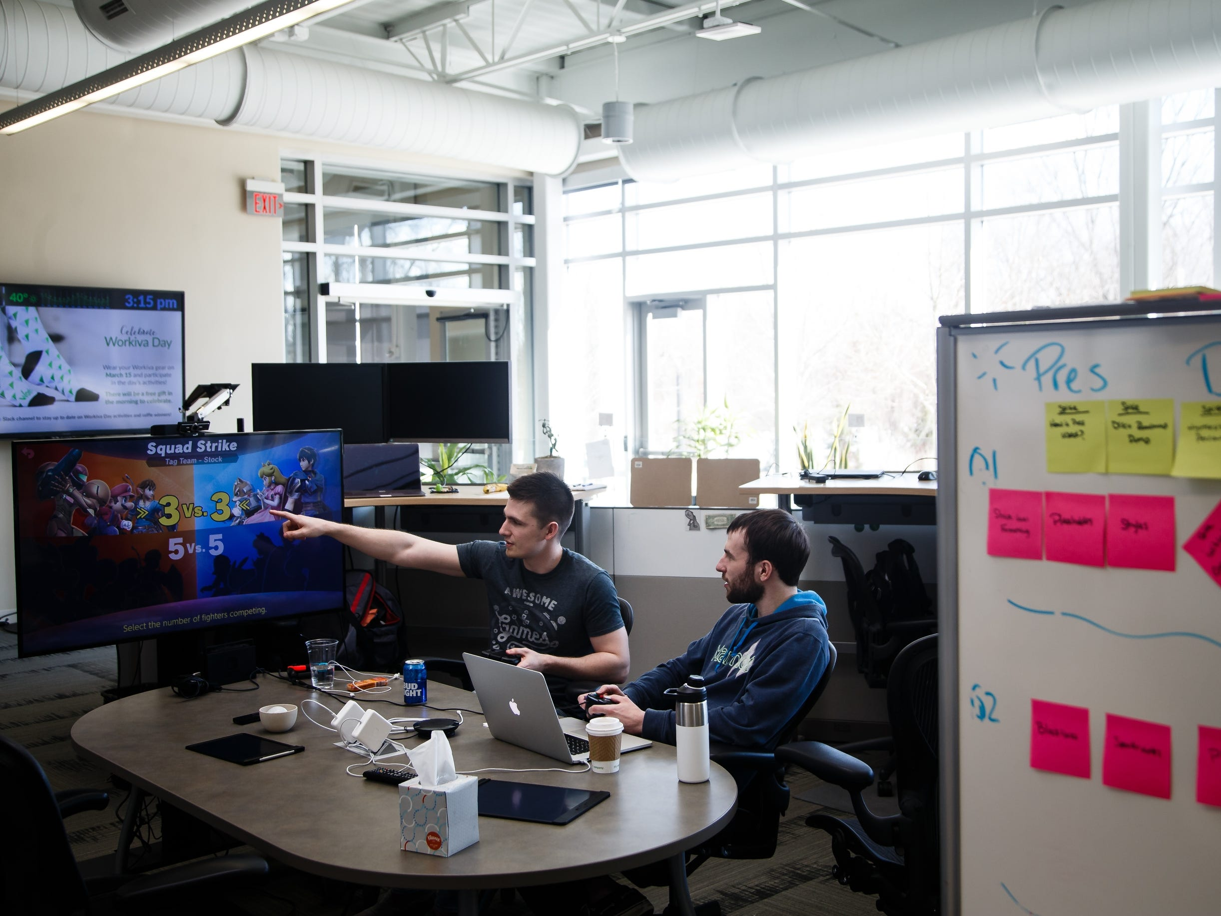 Joey Elliot, 23 of Ames, left, and Kyle Shattuck, 26 of Ames, right take a break to play a game at Workiva, a tech company in Ames on Friday, March 15, 2019.