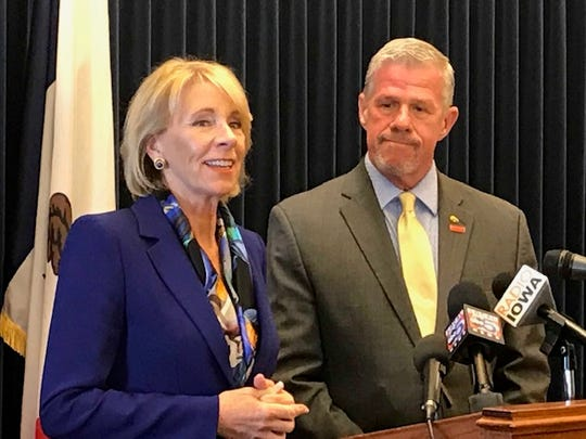 """U.S. Secretary of Education Betsy DeVos visited Des Moines Friday to host a closed-door roundtable on a proposal that would give dollar-for-dollar tax credits for donations to groups that provide scholarships to private schools. Rep. Brad Zaun, R-Urbandale, (right) supports the """"school choice"""" plan."""