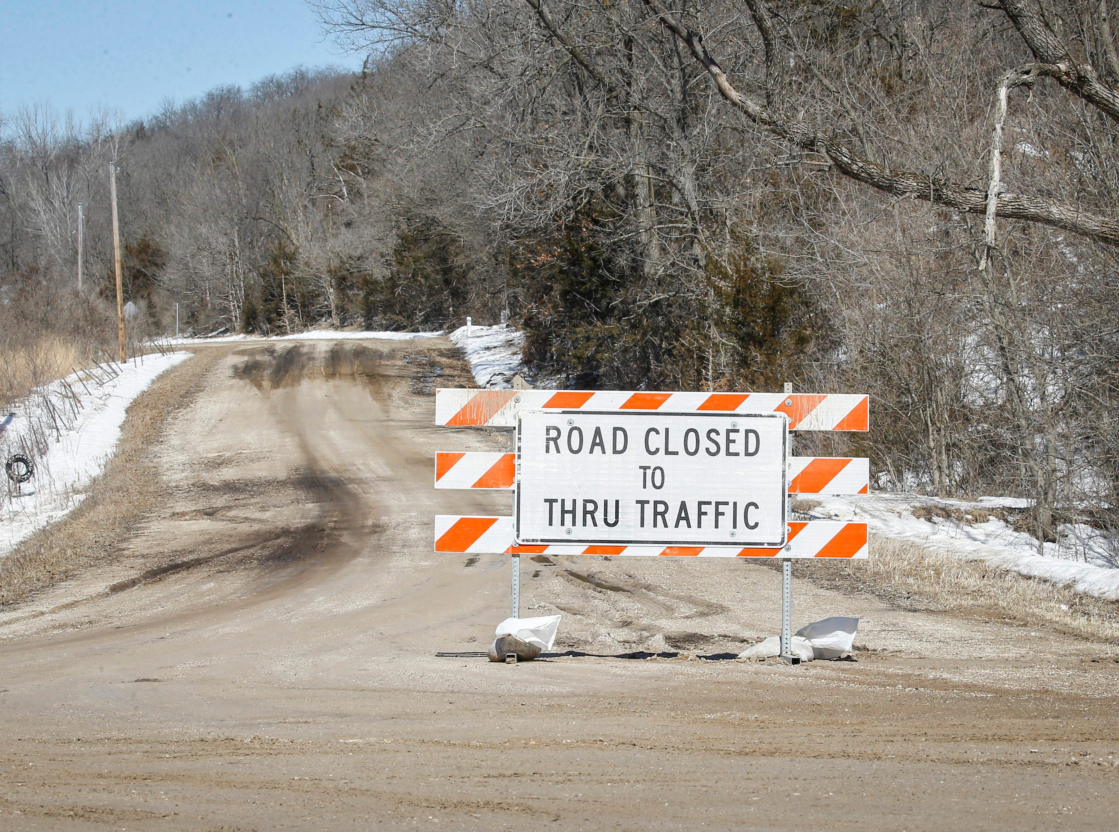 Water from melting snow has caused counties in Iowa to close some secondary roads, like this road near Stratford in Hamilton County, on Friday, March 15, 2019.