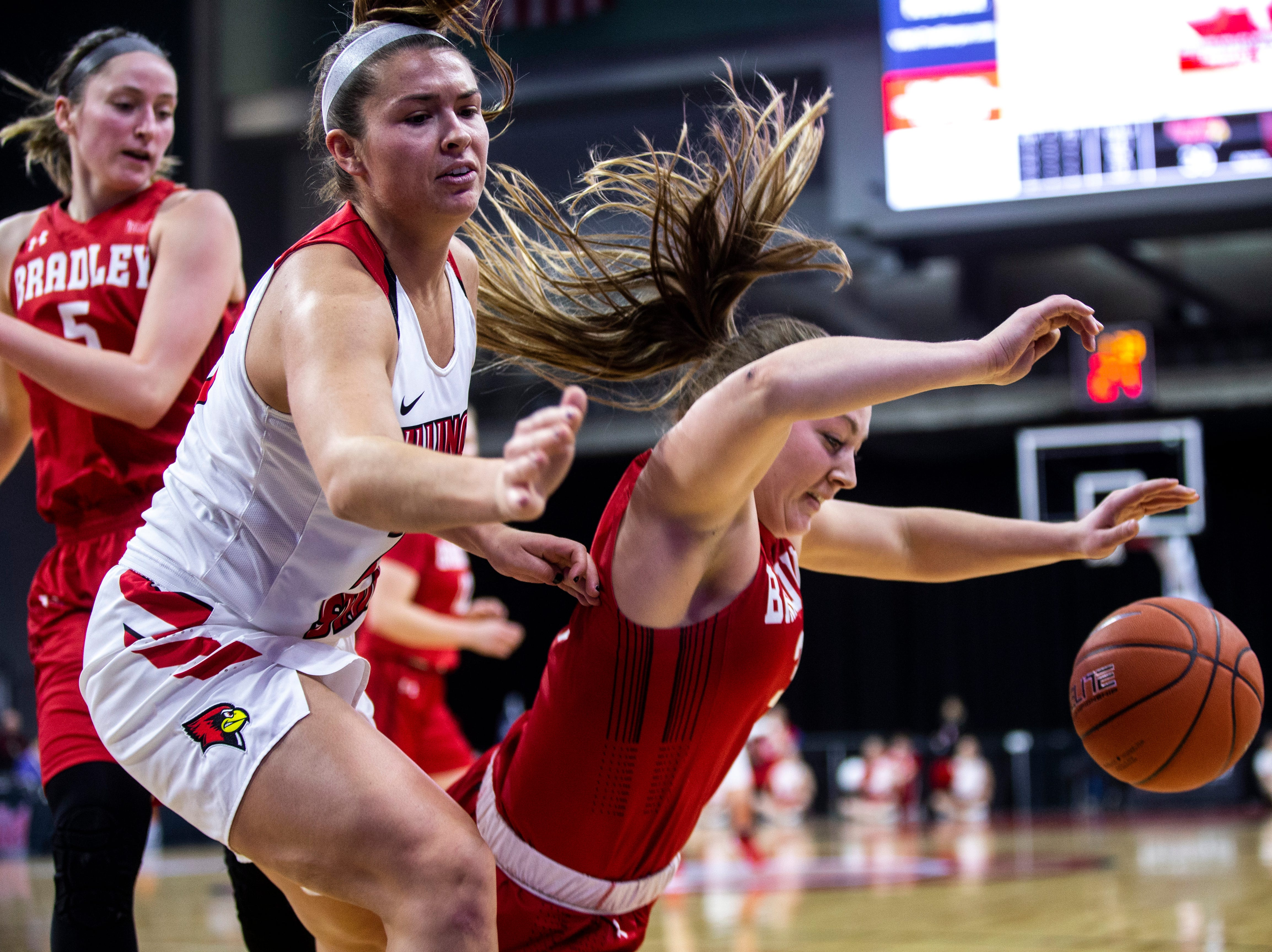 Bradley guard Gabi Haack, right, dives for a loose ball against Illinois State forward Lexi Wallen during a NCAA Missouri Valley Conference women's basketball quarterfinal tournament game, Friday, March 15, 2019, at the TaxSlayer Center in Moline, Illinois.