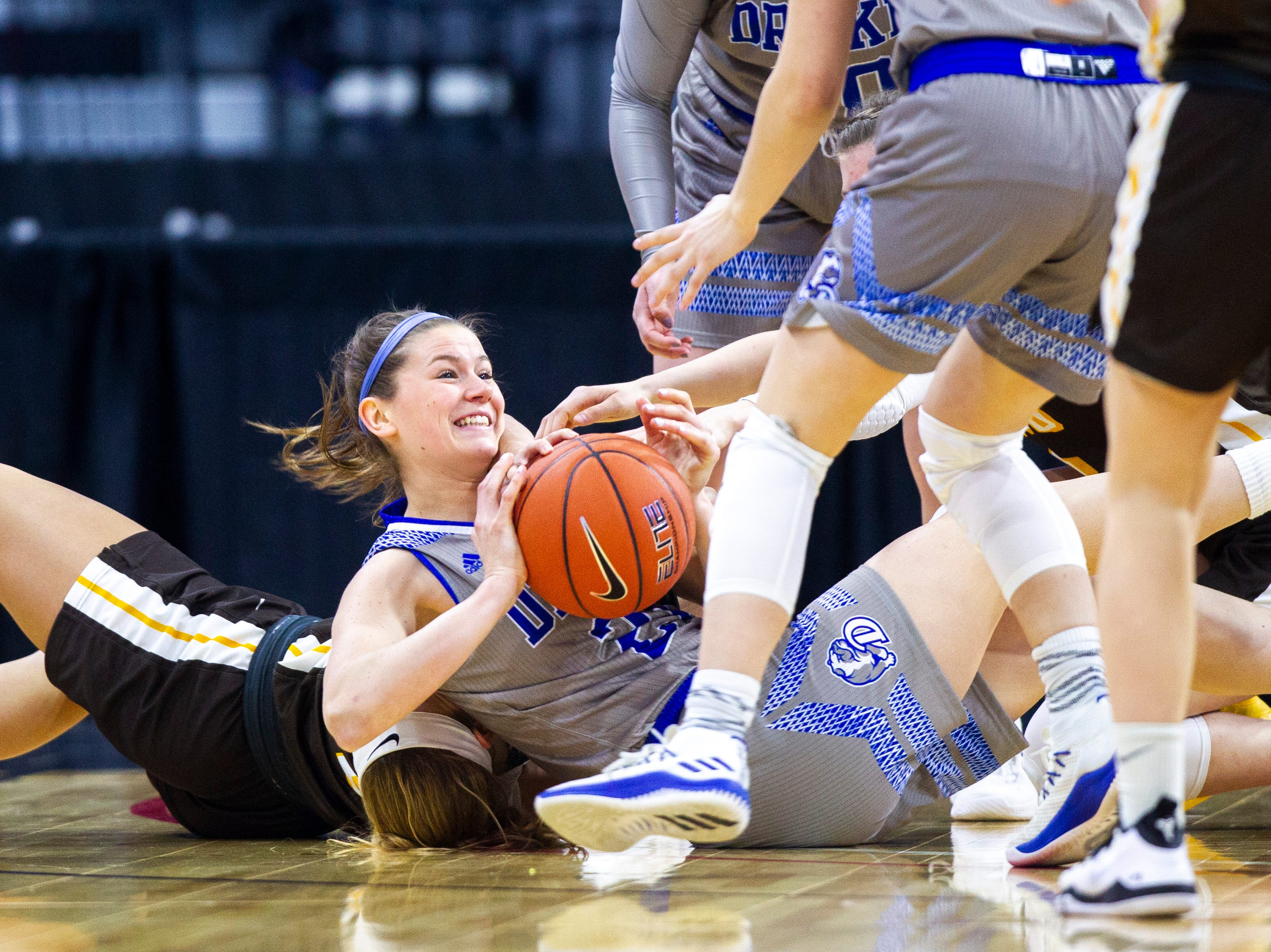 Drake guard Sammie Bachrodt (21) grabs a loose ball during a NCAA Missouri Valley Conference women's basketball quarterfinal tournament game, Friday, March 15, 2019, at the TaxSlayer Center in Moline, Illinois.