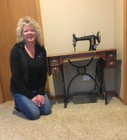 Duinn Shevock, 52, of Cedar Springs, has displayed a Free Press-branded sewing machine in her home for almost 20 years.