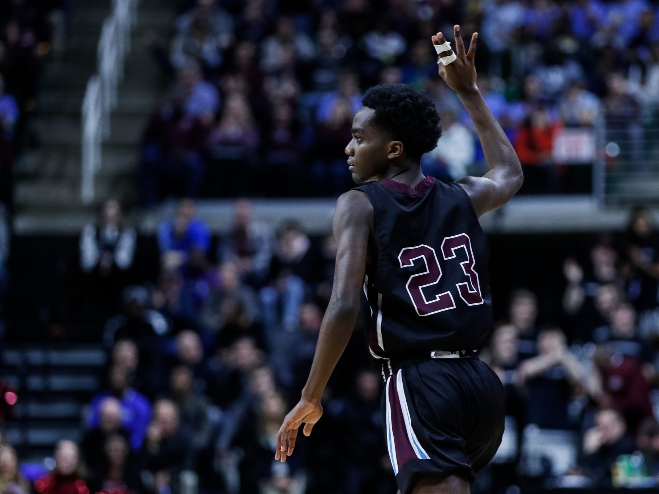 Okemos' Austin Gibson (23) celebrates a 3-pointer against U-D Jesuit during the first half of MHSAA Division 1 semifinal at the Breslin Center in East Lansing, Friday, March 15, 2019.