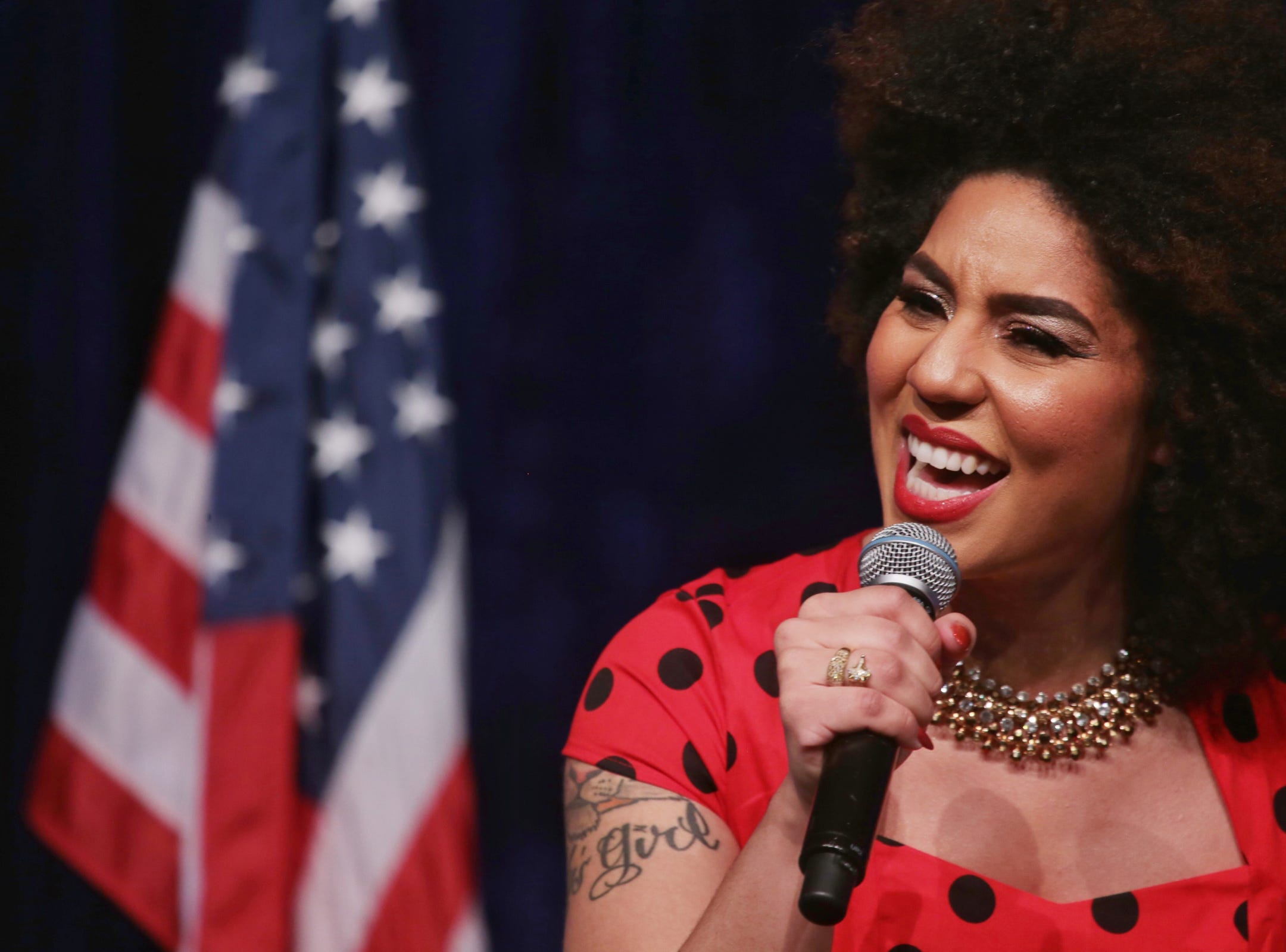 "Joy Villa sings the National Anthem during Steve Bannon's nationwide tour stop named ""We Build the Wall"" in support Trump's wish for $7-billion expansion of border wall with Mexico, aimed at stopping illegal immigration on Thursday, March 14, 2019 at Cobo Center in downtown Detroit."