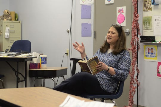 """Substitute teacher Jayne Polaski leads a reading of """"Bridge to Terabithia"""" by Katherine Paterson on March 15, 2019, in Kimball Township, Michigan."""
