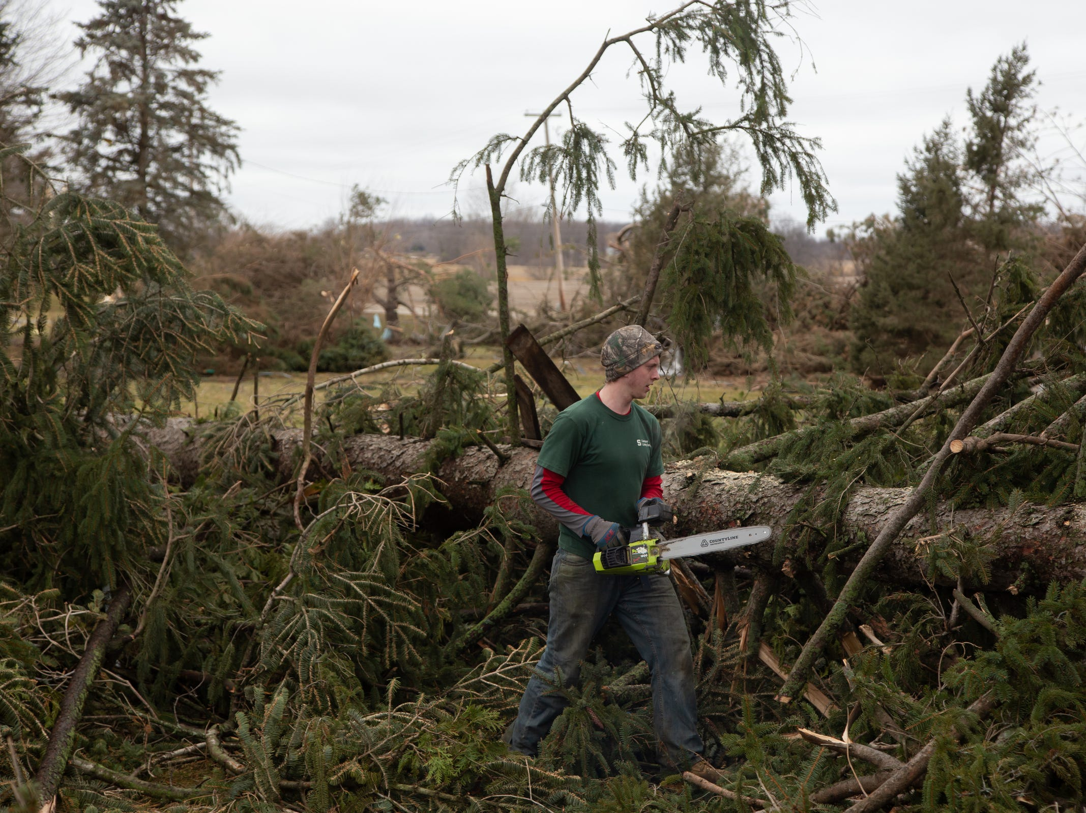 "Josh Randell of Bancroft helps clear downed trees from his grandmother's yard on Friday, March 15, 2019 after a tornado moved through Shiawassee County overnight. ""It was surprising that I didn't hear any wind or anything and all of the sudden my grandpa called me and said my trees are down,"" Randell said who lives down the street and went to the house last night. ""I always wanted to see a tornado but missed by little second."""