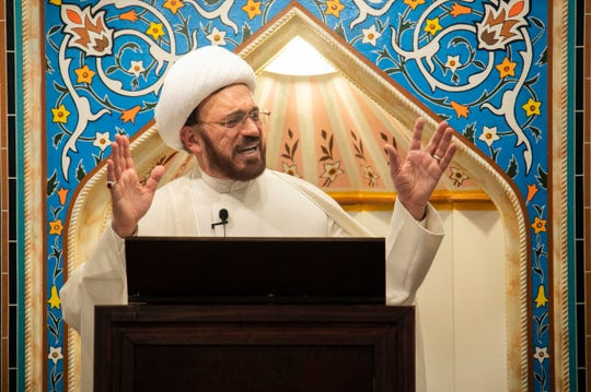 Imam Mohammad Ali Elahi speaks during prayers at the Islamic House of Wisdom in Dearborn Heights on Friday, March 15, 2019.
