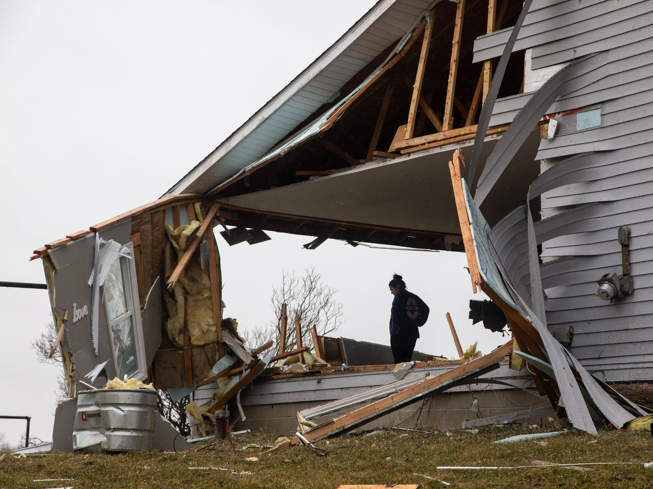 Mackenzie Weaver helps clear items from the living room area of her mother's home in Bancroft on Friday, March 15, 2019