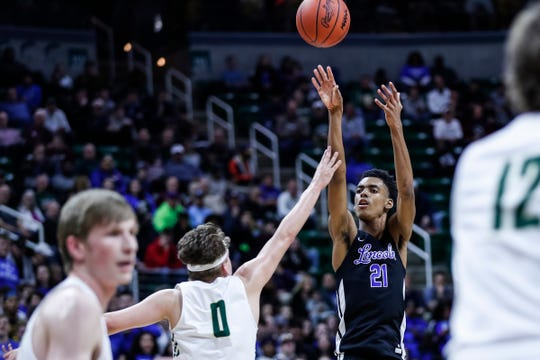 Ypsilanti Lincoln's Emoni Bates (21) attempts for a 3-point basket against Howell during the first half of MHSAA Division 1 semifinal at the Breslin Center in East Lansing, Friday, March 15, 2019.