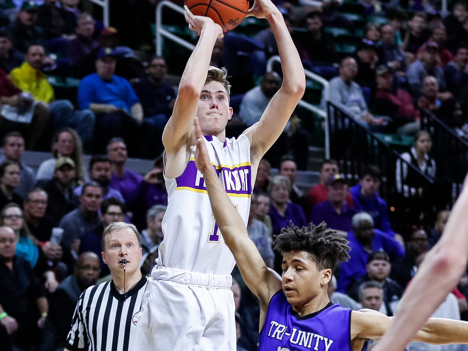 Frankfort's Will Newbold (14) attempts for a 3-point basket against Wyoming Tri-unity Christian's Brady Titus (25) during the first half of MHSAA Division 4 semifinal at the Breslin Center in East Lansing, Thursday, March 14, 2019.