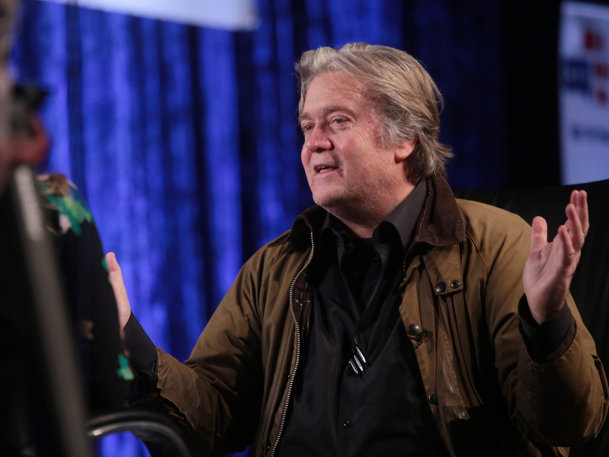 "Steve Bannon, former Exec. Chair of far-right Breitbart News & former chief strategist of Trump White House talks in an interview before speaking at Cobo Center in downtown Detroit on Thursday, March 14, 2019 during stop on his nationwide tour named ""We Build the Wall"" in support Trump's wish for $7-billion expansion of border wall with Mexico, aimed at stopping illegal immigration."