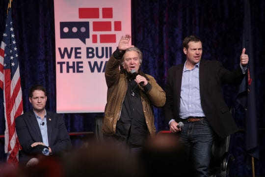 "Steve Bannon, former Exec. Chair of far-right Breitbart News & former chief strategist of Trump White House waves to crowd after speaking at Cobo Center in downtown Detroit on Thursday, March 14, 2019 during stop on his nationwide tour named ""We Build the Wall"" in support Trump's wish for $7-billion expansion of border wall with Mexico, aimed at stopping illegal immigration."