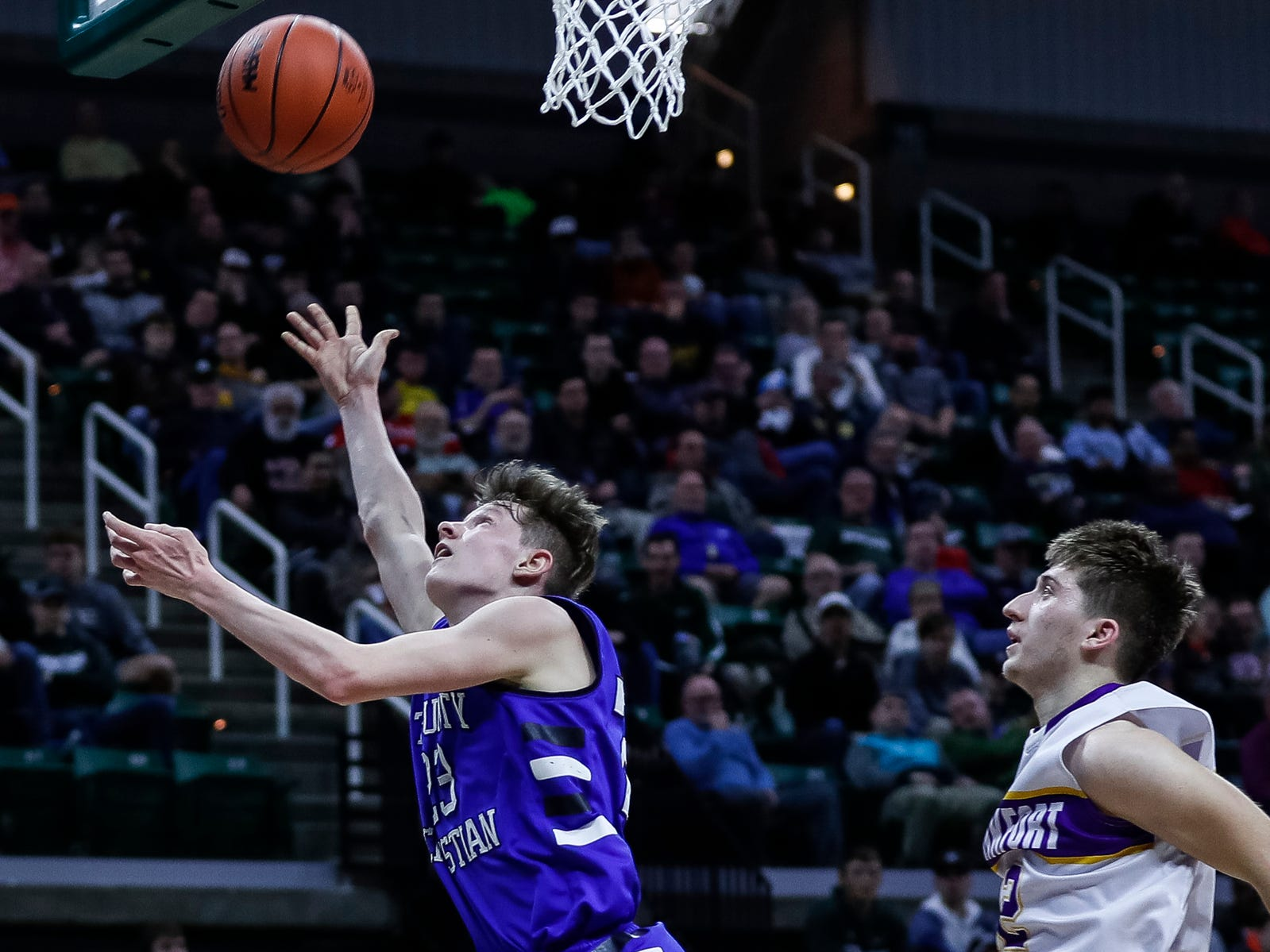 Wyoming Tri-unity Christian's Colin DeKlyen (23) makes a layup against Frankfort during the first half of MHSAA Division 4 semifinal at the Breslin Center in East Lansing, Thursday, March 14, 2019.