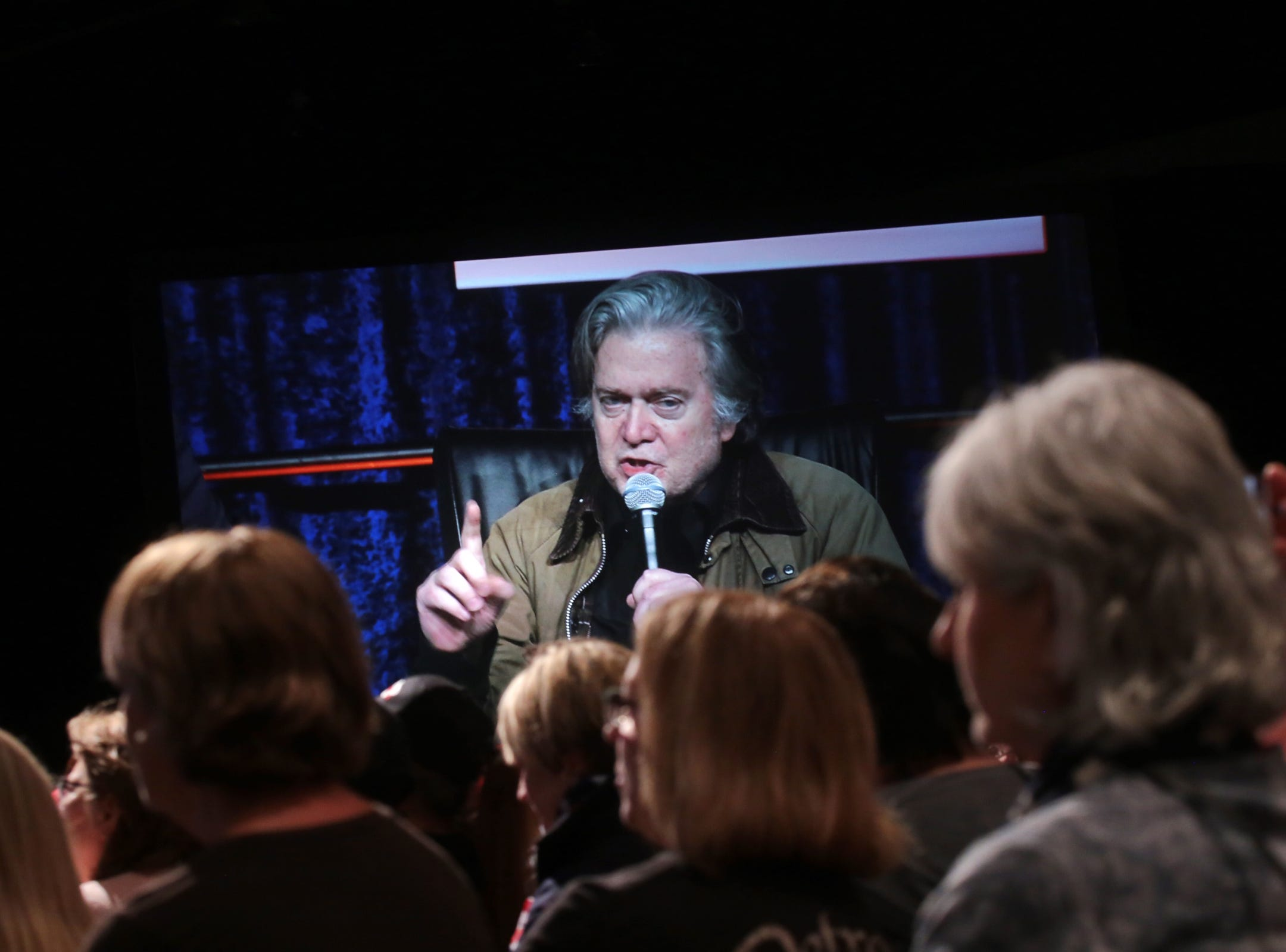 """Supporters listen as Steve Bannon's nationwide tour stop named """"We Build the Wall"""" in support Trump's wish for $7-billion expansion of border wall with Mexico, aimed at stopping illegal immigration on Thursday, March 14, 2019 at Cobo Center in downtown Detroit."""