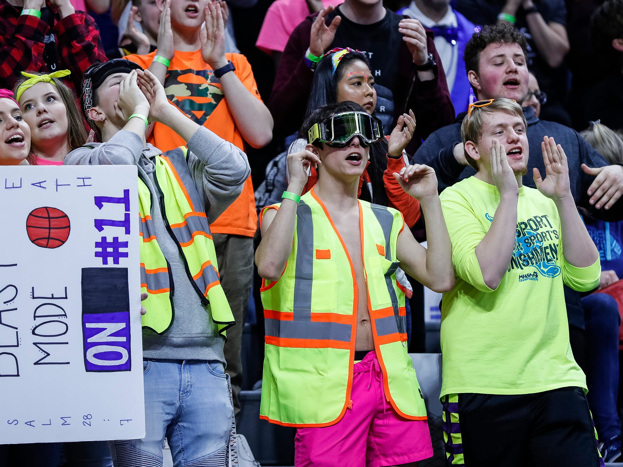Wyoming Tri-unity Christian students cheer for the Defenders during the first half of MHSAA Division 4 semifinal against Frankfort at the Breslin Center in East Lansing, Thursday, March 14, 2019.